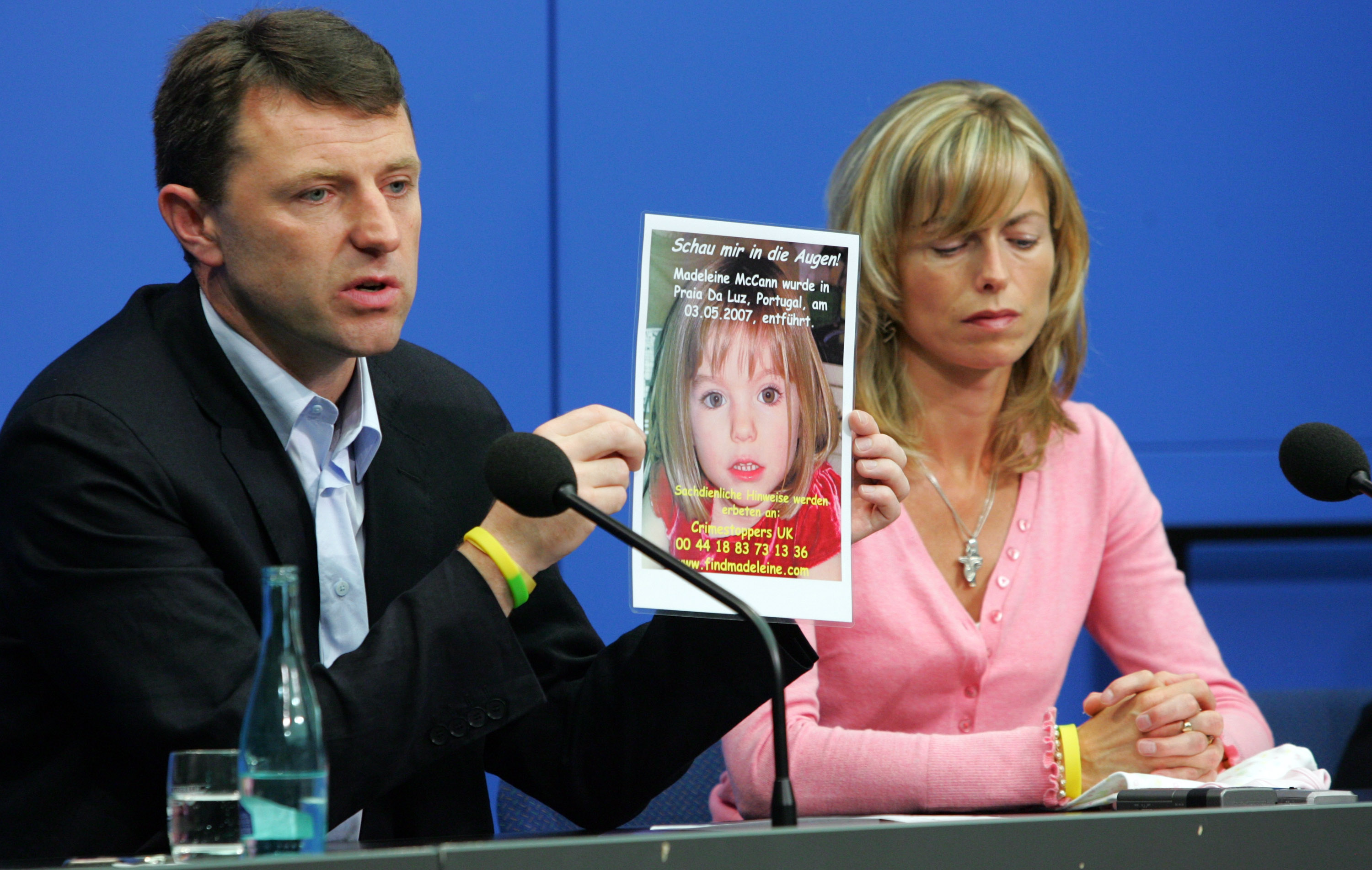 Kate and Gerry McCann, the parents of the missing four-year-old British girl Madeleine McCann, hold up a picture of Madeleine during a press conference on June 6, 2007, in Berlin, Germany. Kate and her husband Gerry are in Berlin to spread the word in the search for their missing duaghter Madeleine who disappeared from their holiday apartment in Praia da Luz, Portugal on May 3, 2007. (Getty Images)