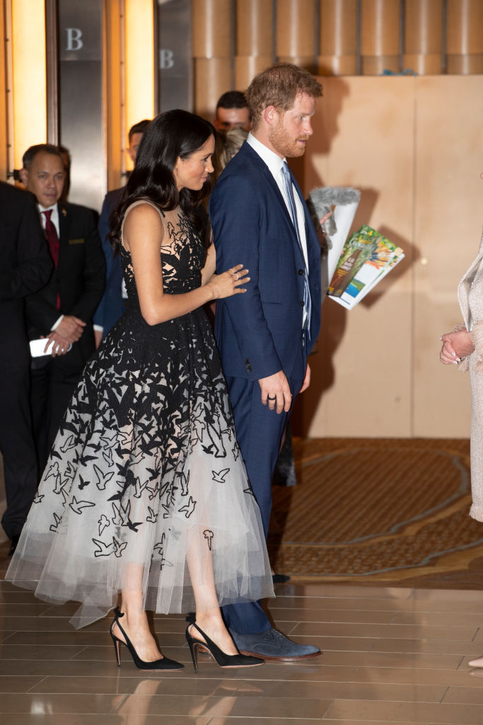 Prince Harry - who is the Commonwealth youth ambassador - and Meghan spent about 30 minutes hearing about mental health projects operating in the country. (Source: Getty Images)