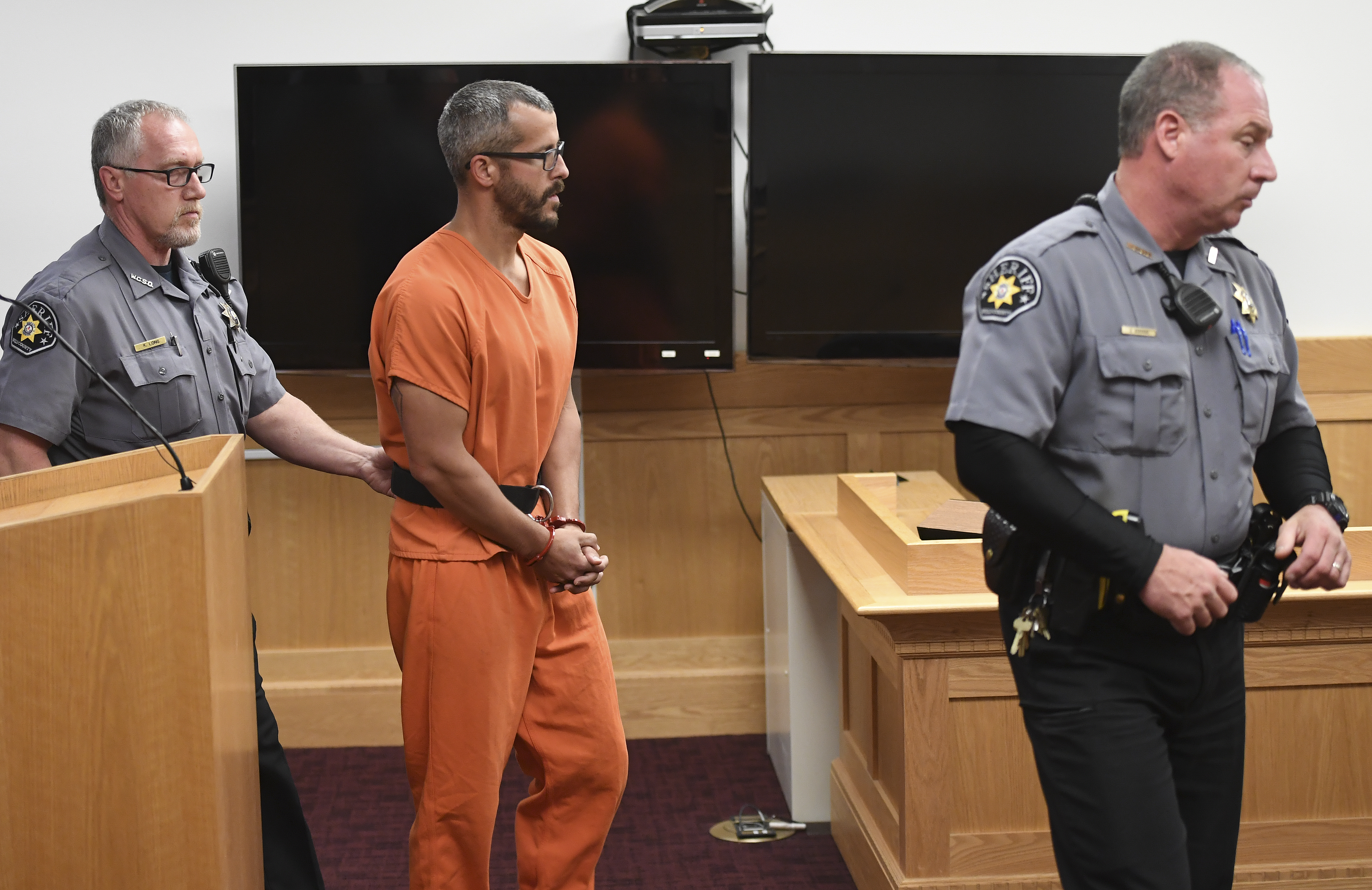Christopher Watts is in court for his arraignment hearing at the Weld County Courthouse on August 21, 2018 in Greeley, Colorado. Watts faces nine charges, including several counts of first-degree murder of his wife and his two young daughters.