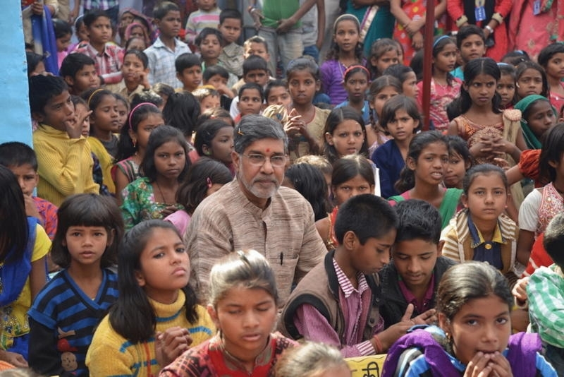 Nobel Peace Laureate Kailash Satyarthi, the subject of THE PRICE OF FREE, surrounded by others. (Photo by Derek Doneen )