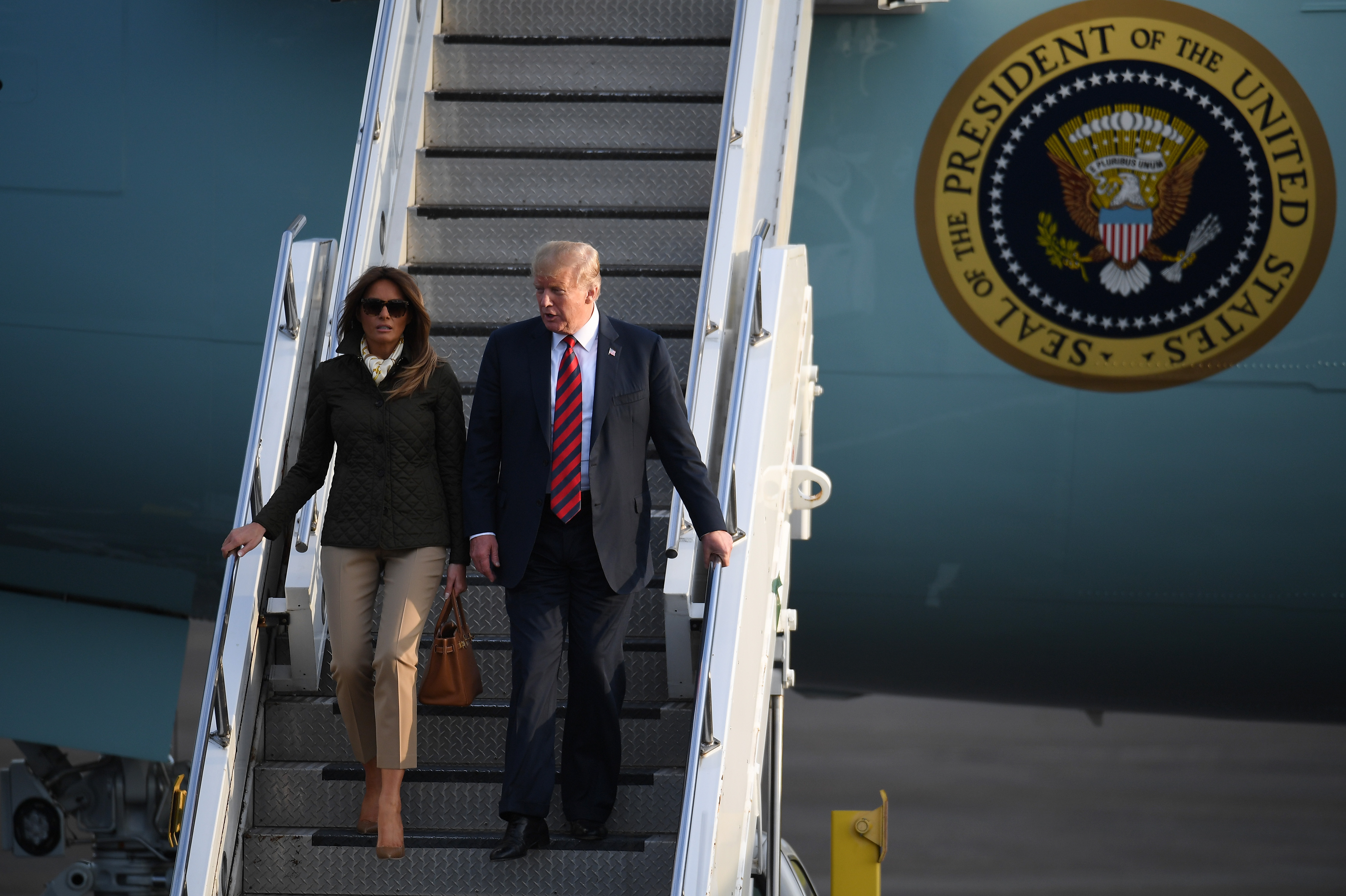 The President of the United States, Donald Trump and First Lady, Melania Trump arrive at Glasgow Prestwick Airport on July 13, 2018 in Glasgow, Scotland.