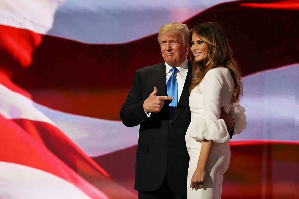 Presumptive Republican presidential nominee Donald Trump gestures to his wife Melania after she delivered a speech on the first day of the Republican National Convention on July 18, 2016, at the Quicken Loans Arena in Cleveland, Ohio. (Photo by Joe Raedle/Getty Images)