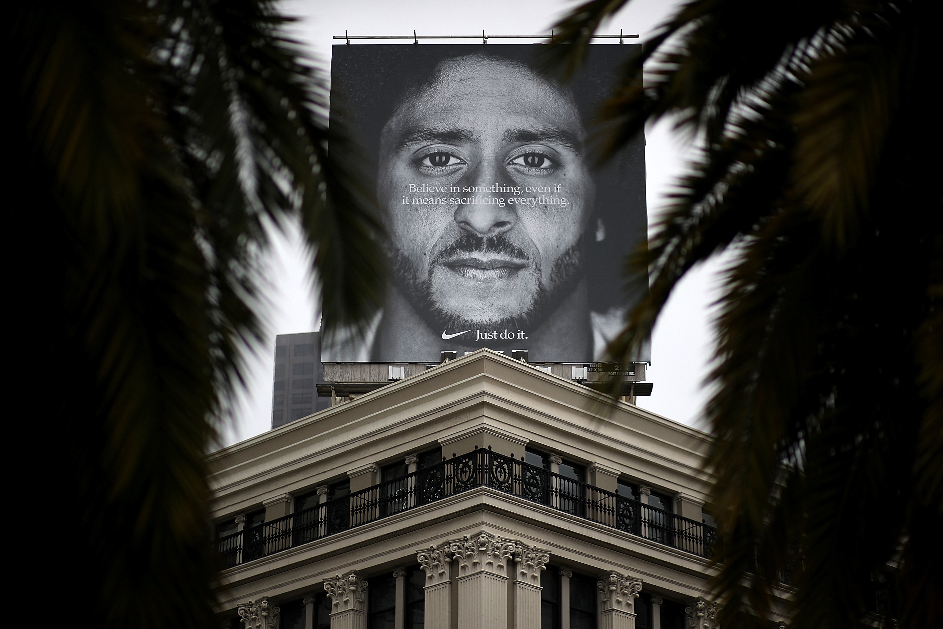 A billboard featuring former San Francisco 49ers quaterback Colin Kaepernick is displayed on the roof of the Nike Store on September 5, 2018 in San Francisco, California. Nike launched an ad campaign to commemorate the 30th anniversary of its iconic 'Just Do It' motto that features controversial former NFL quarterback Colin Kaepernick and a message that says 'Believe in something. Even if it means sacrificing everything.'