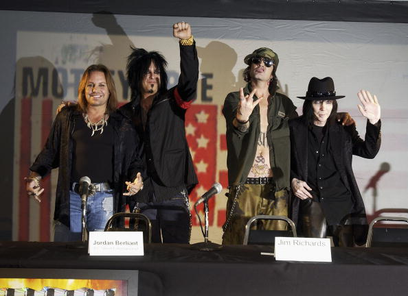 The original members of Motley Crue (L to R) Vince Neil, Nikki Sixx, Tommy Lee and Mick Mars reunite after six years to announce 'Red, White & Crue Tour 2005...Better Live than Dead' on December 6, 2004, at the Hollywood Palladium in Los Angeles, California. (Source: Amanda Edwards/Getty Images)