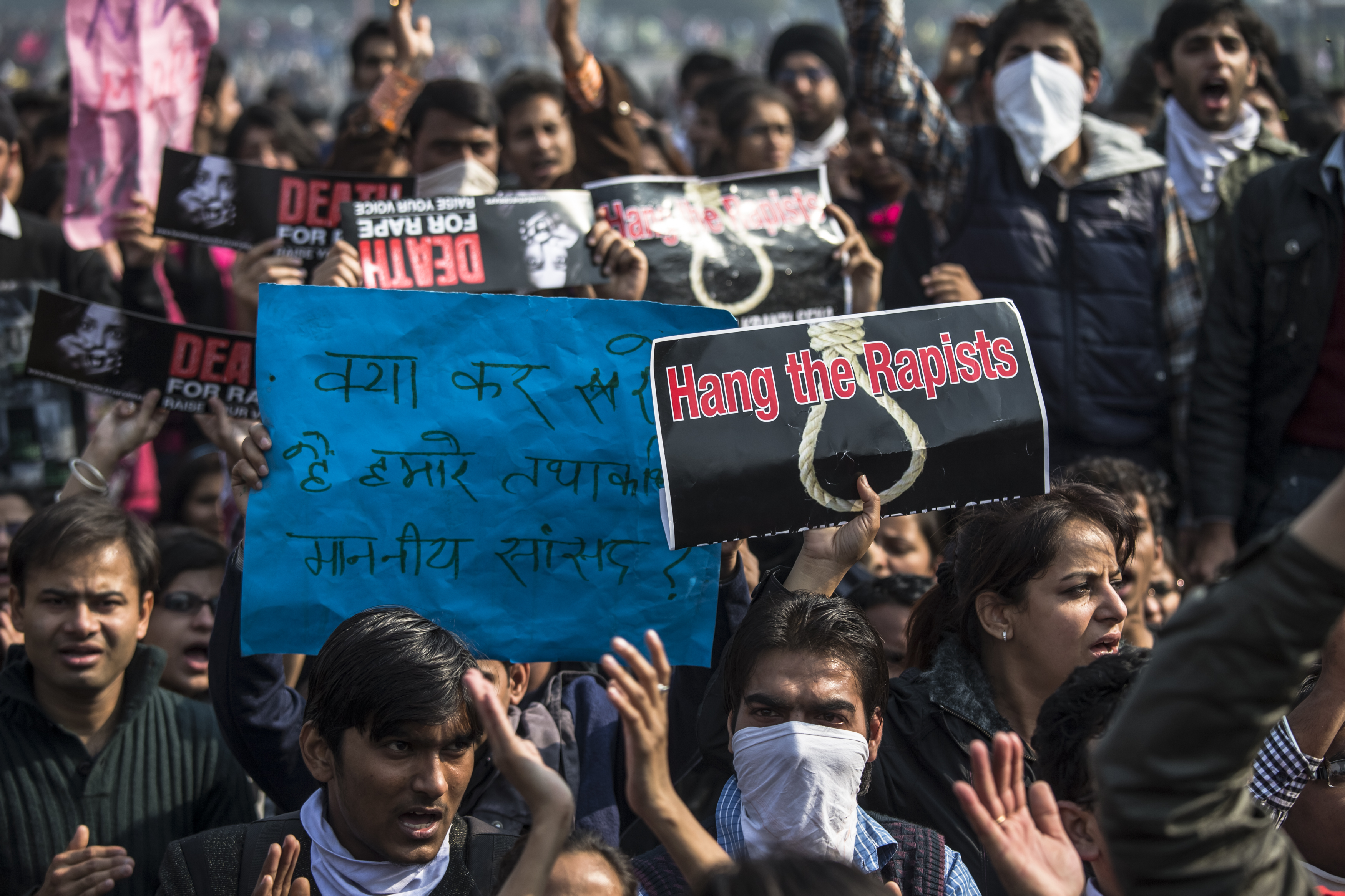 Students hold up placards as they chant slogans in front of a Police cordon during a protest against the Indian government's reaction to recent rape incidents in India in front of the Presidential Palace on December 22, 2012, in New Delhi, India. (Getty)