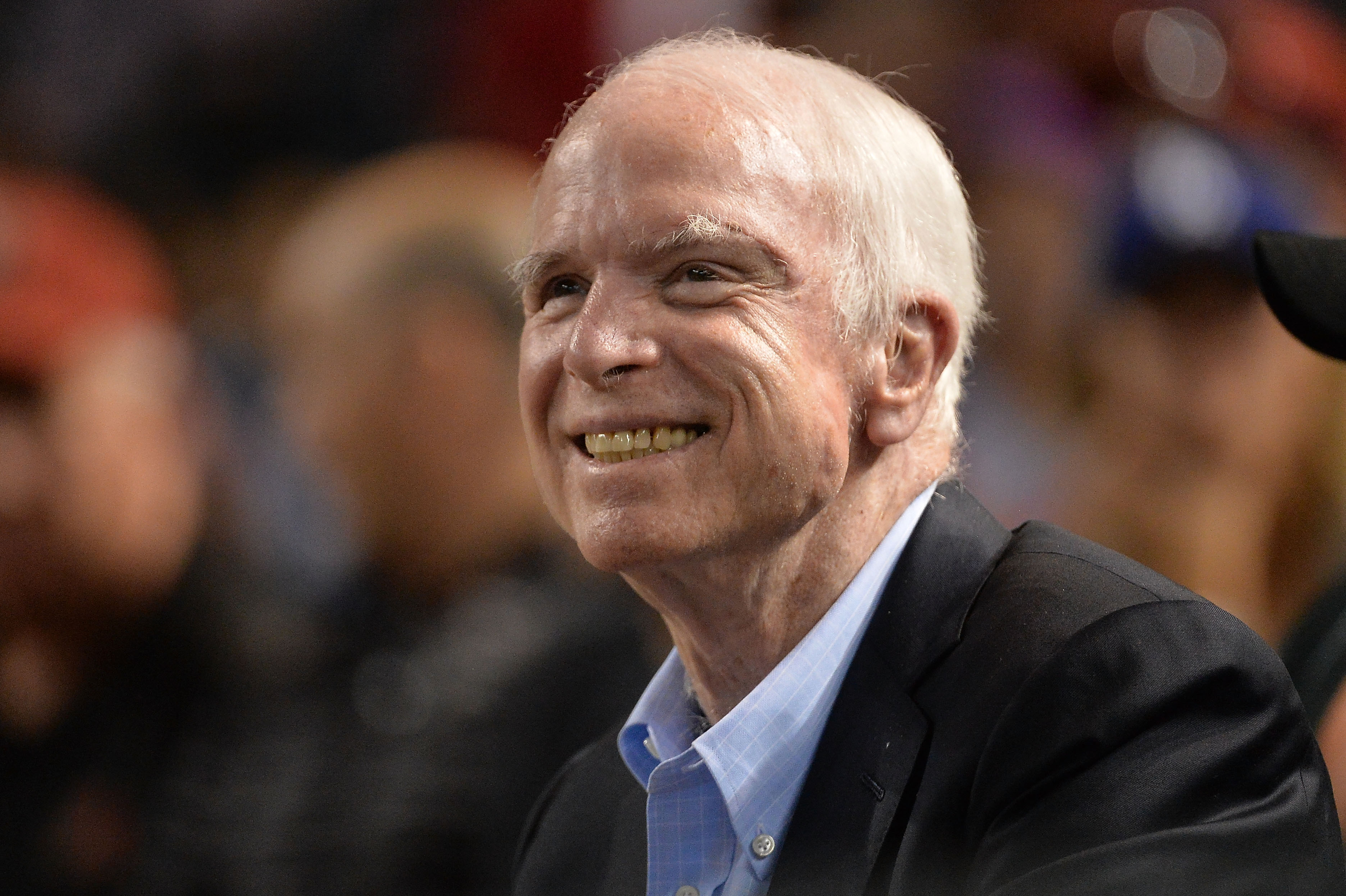 Senator John McCain smiles while attending the MLB game between the Los Angeles Dodgers and Arizona Diamondbacks at Chase Field on August 10, 2017 in Phoenix, Arizona.