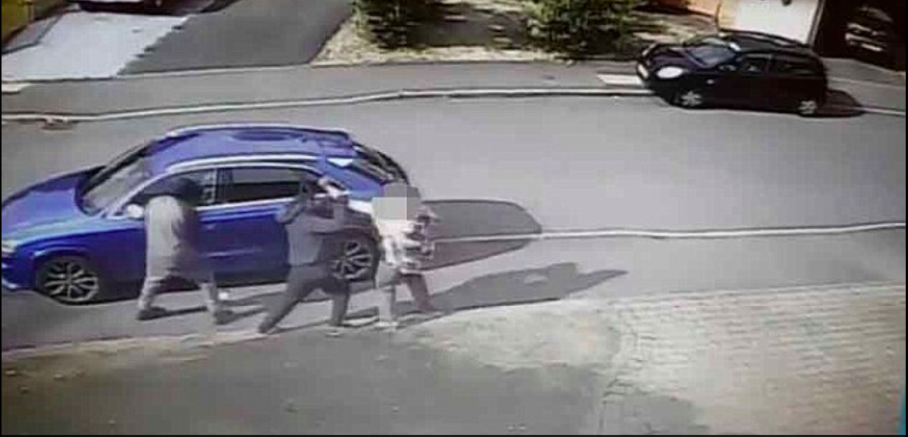 The grandmother can be seen involved in a tussle with the carjackers.
