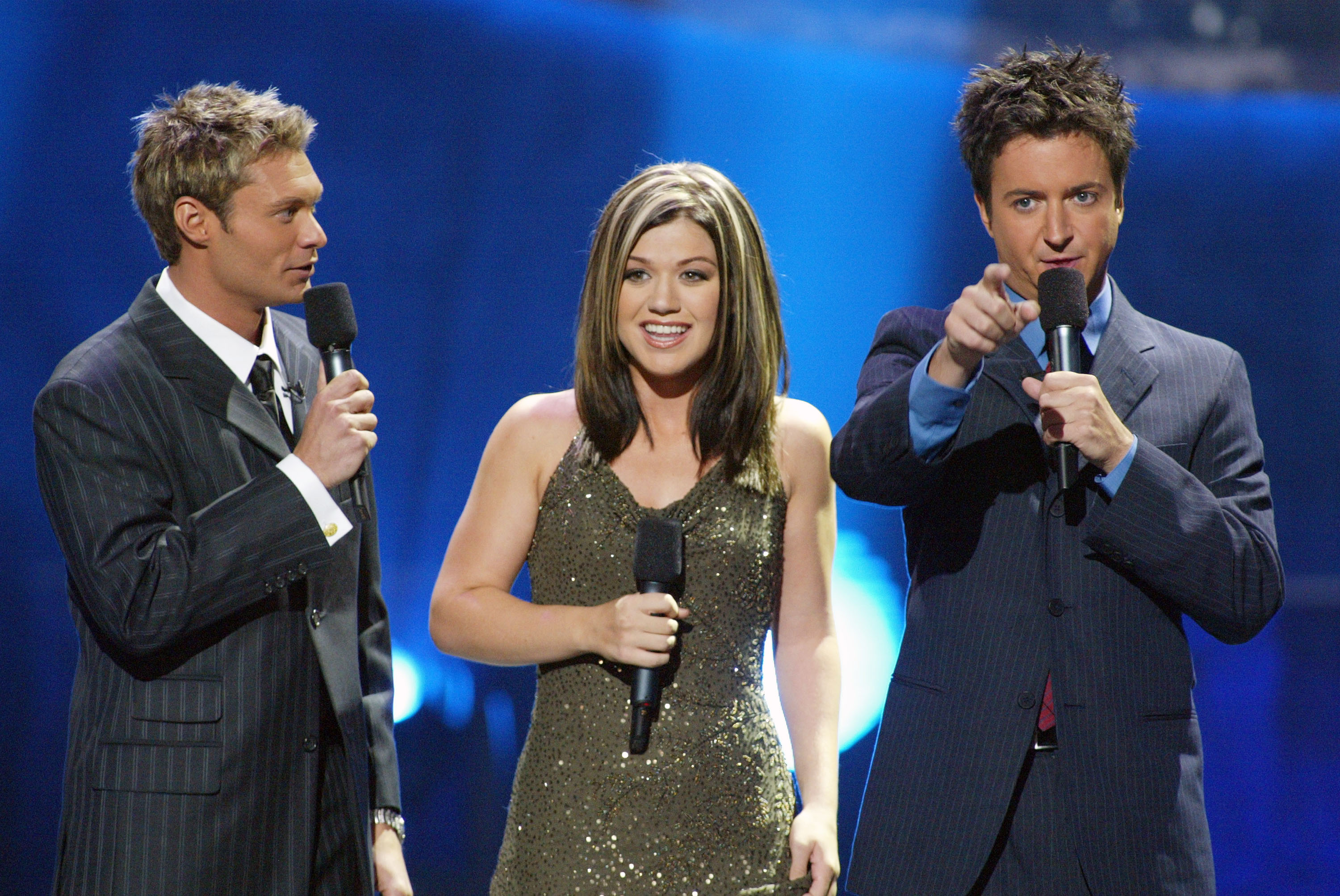 Ryan Seacrest, Kelly Clarkson and Brian Dunkleman at FOX-TV's 'American Idol' finals at the Kodak Theatre in Hollywood, Ca. Tuesday, Sept. 3, 2002. (Kevin Winter/Getty Images)