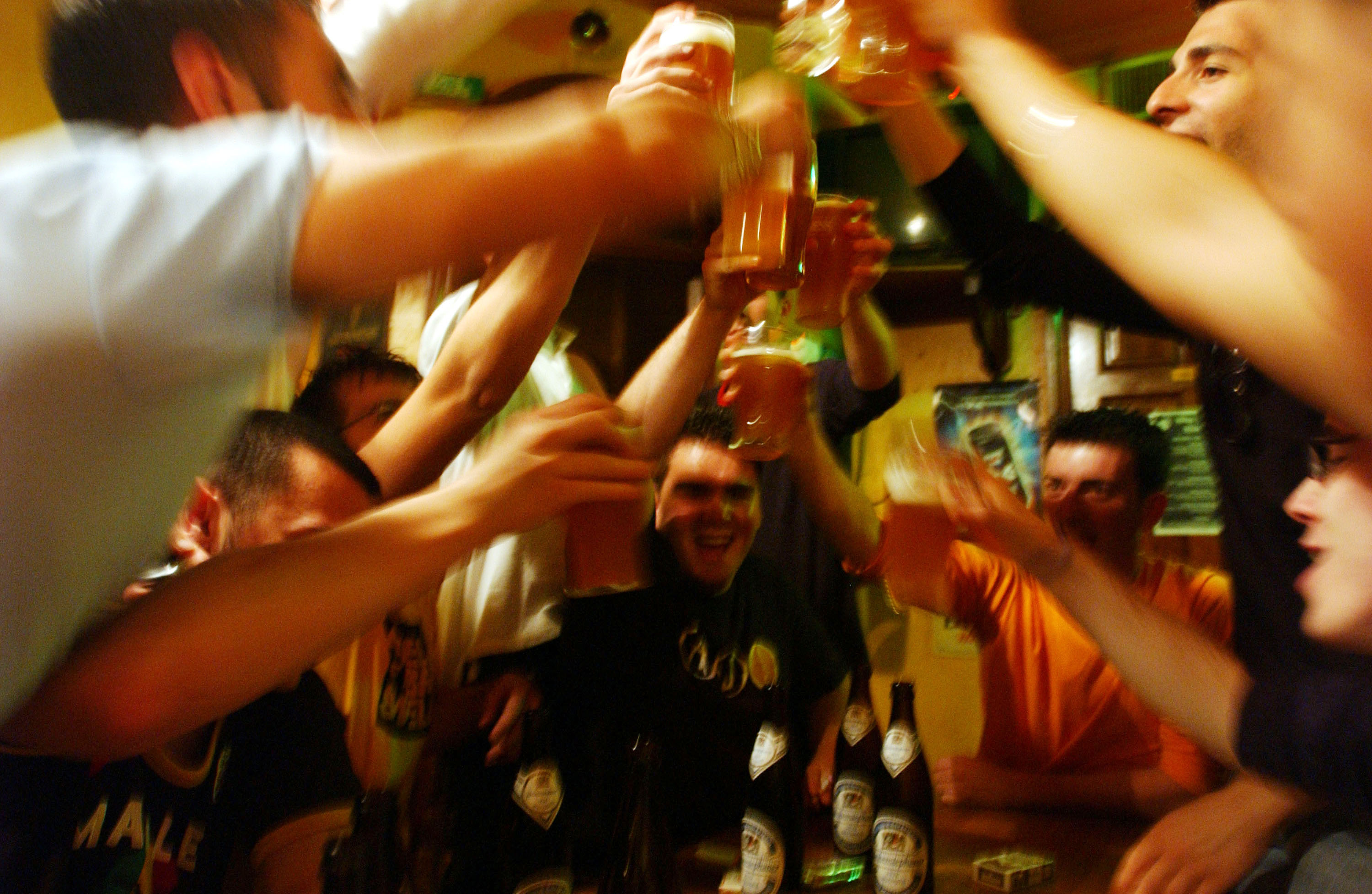 Italian students from the Primo Levi Technical Institute of Vignola in the Modena Province, toast with glasses of beer in a pub during a school trip to Strasbourg, France to visit the European Parliament on May 18, 2004 (Getty Images)