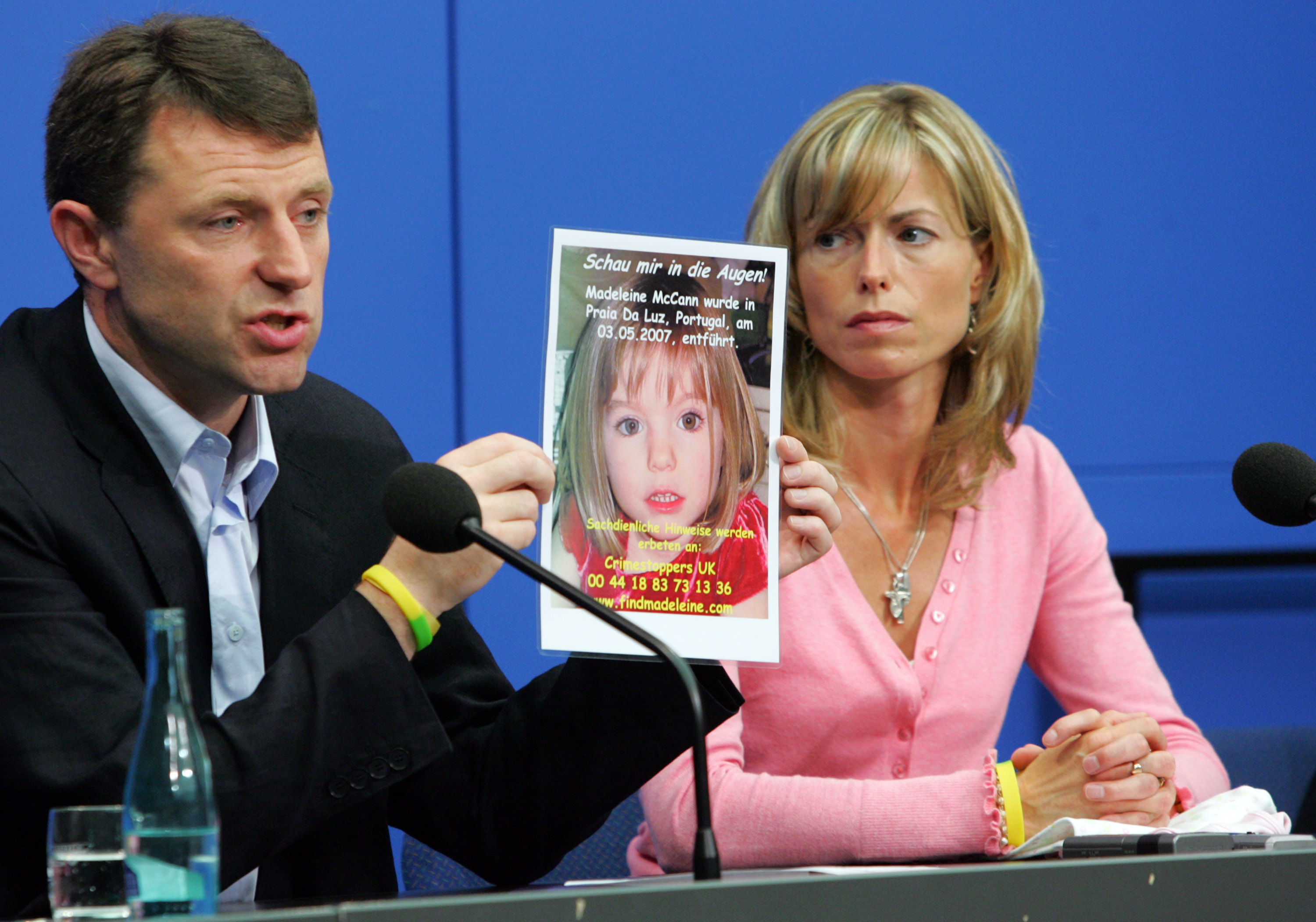 Kate and Gerry McCann, the parents of the missing 4-year-old British girl Madeleine McCann, display a poster of their missing daughter during a press conference on June 6, 2007 in Berlin, Germany. Kate and her husband Gerry are in Berlin to spread the word in the search for their missing duaghter Madeleine who disappeared from their holiday apartment in Praia da Luz, Portugal on May 3, 2007.