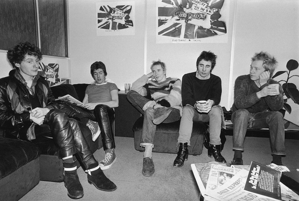 Notorious British punk rock band The Sex Pistols at the EMI studios, 2nd December 1976. From left to right, manager Malcolm McLaren, Steve Jones, Johnny Rotten (John Lydon), Glen Matlock and Paul Cook. (Source: R. Jones/Evening Standard/Hulton Archive/Getty Images)
