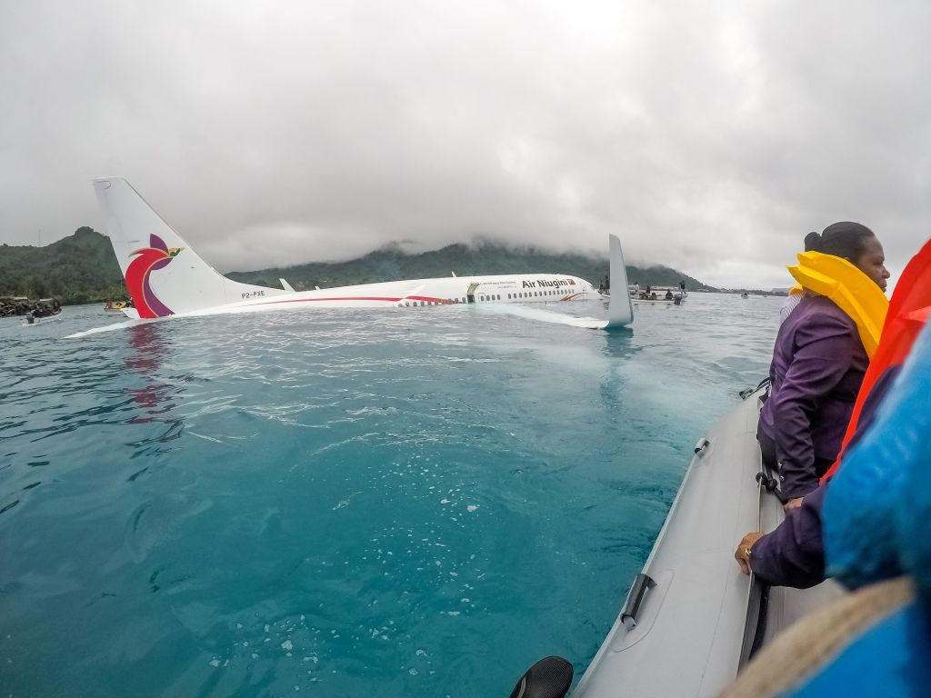 U.S. Navy Sailors from Underwater Construction Team (UCT) 2 assist local authorities in shuttling the passengers and crew of Air Niugini flight PX56 to shore following the plane crashing into the sea on its approach to Chuuk International Airport on September 28, 2018, in the Federated States of Micronesia. (Getty Images)