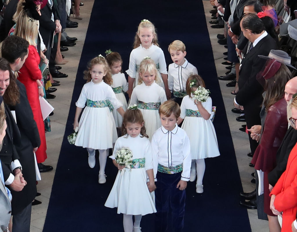The bridesmaids and pageboys, including Princess Charlotte (back left) and Prince George (back right) walk down the aisle following the wedding of Princess Eugenie of York and Jack Brooksbank at St George's Chapel in Windsor Castle on October 12, 2018, in Windsor, England. (Getty Images)