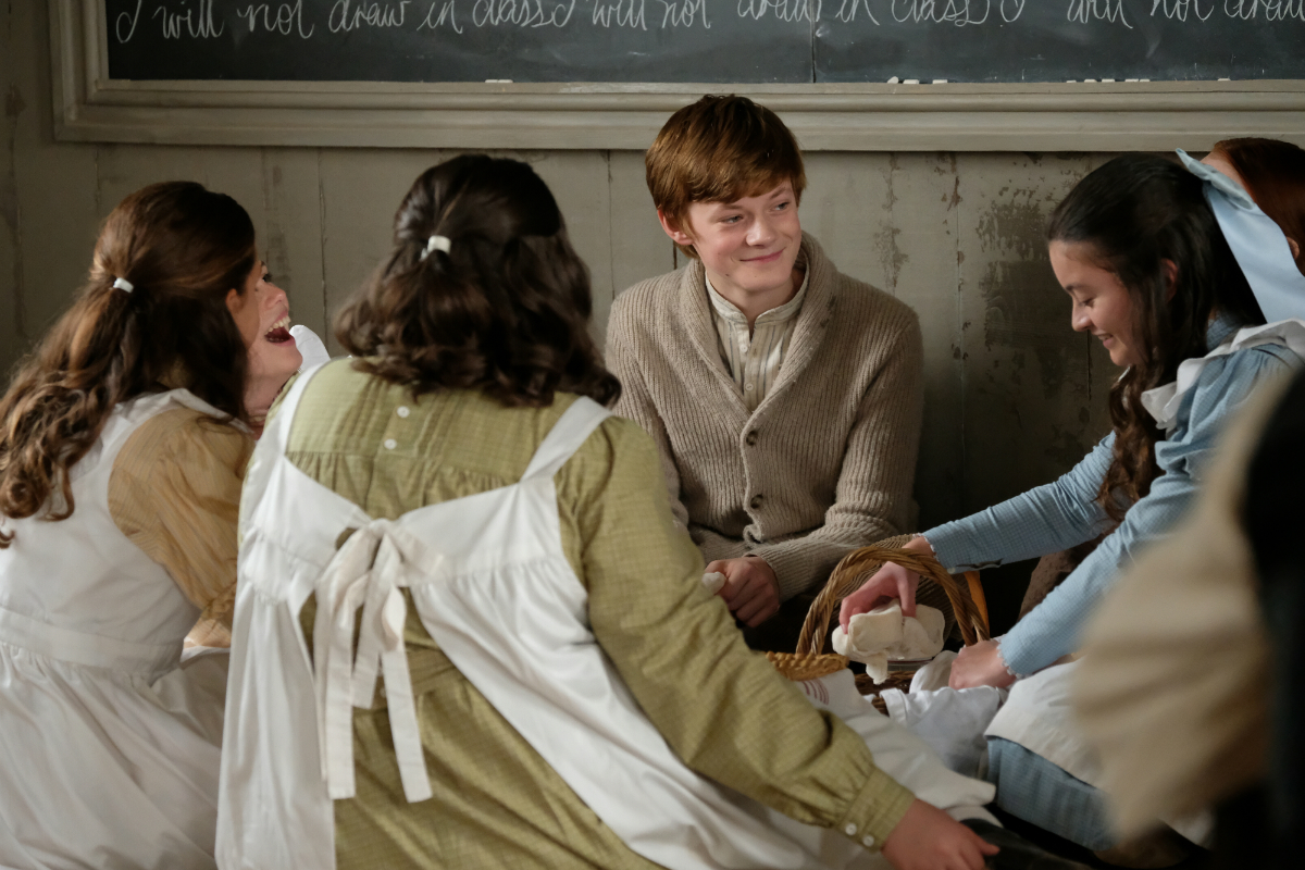 Cole sits with the girls of his school in Netflix's 'Anne with an E' (Netflix)