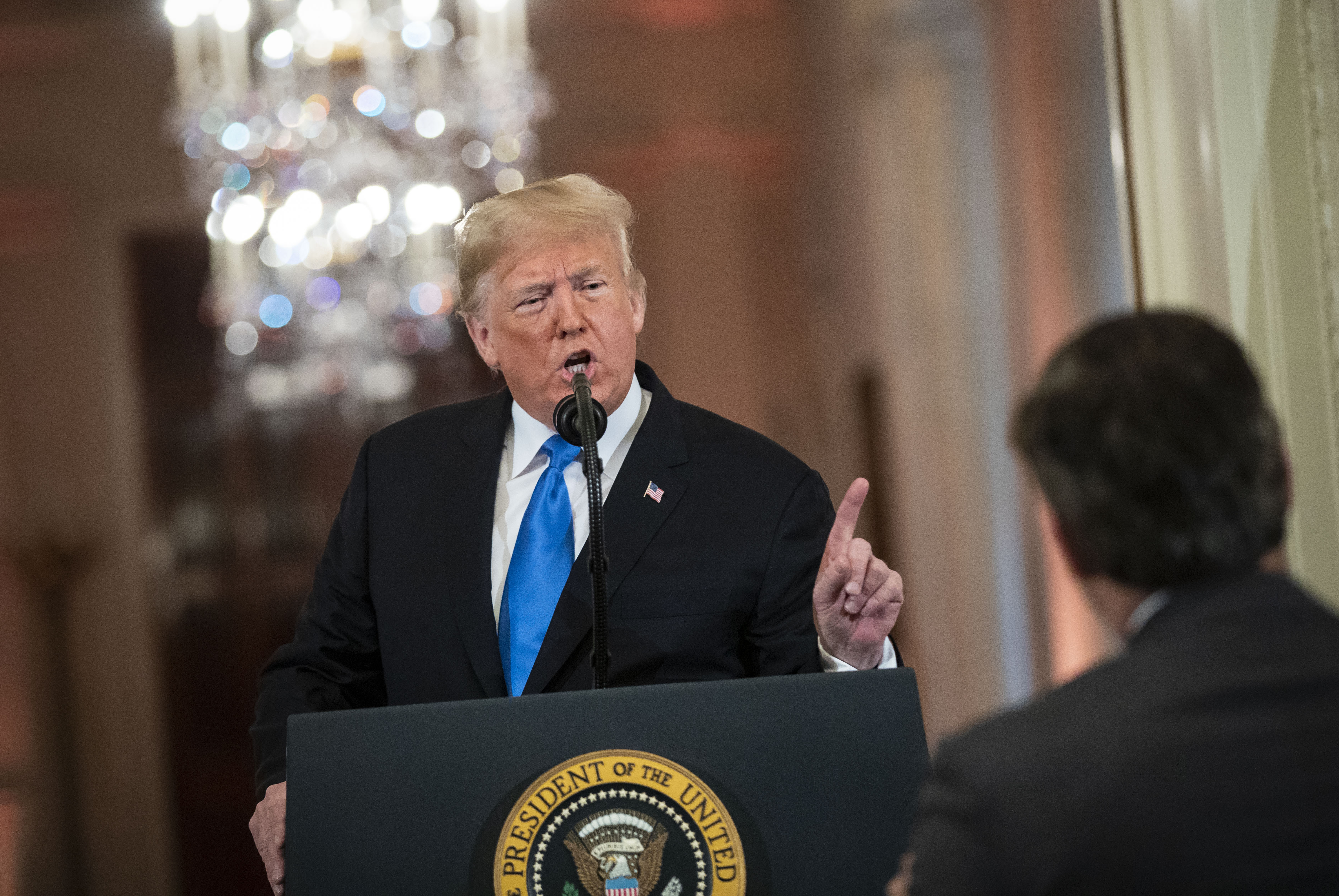 (AFP OUT) U.S. President Donald Trump gets into an exchange with CNN reporter Jim Acosta during a news conference a day after the midterm elections on November 7, 2018 in the East Room of the White House in Washington, DC. Republicans kept the Senate majority but lost control of the House to the Democrats.