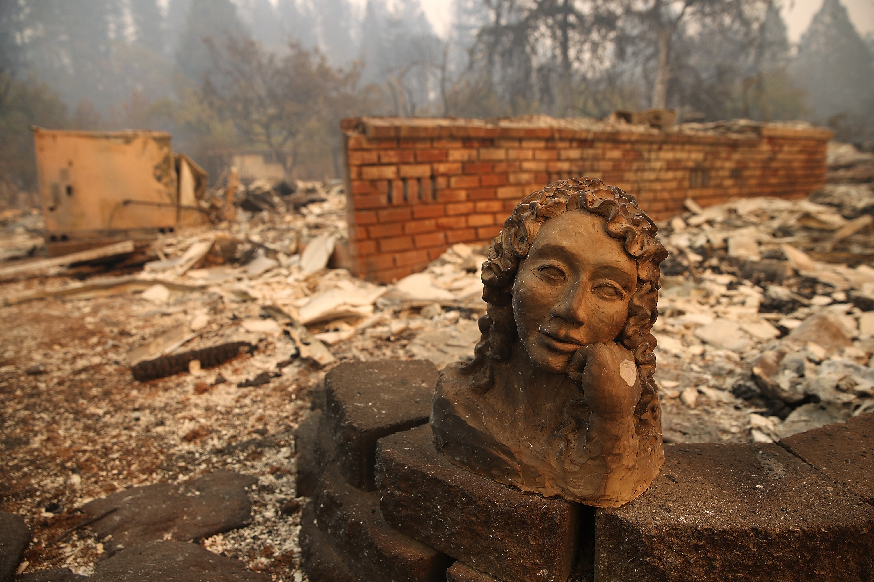 A statue remains in front of a home that was destroyed by the Camp Fire on November 10, 2018, in Paradise, California. (Getty)