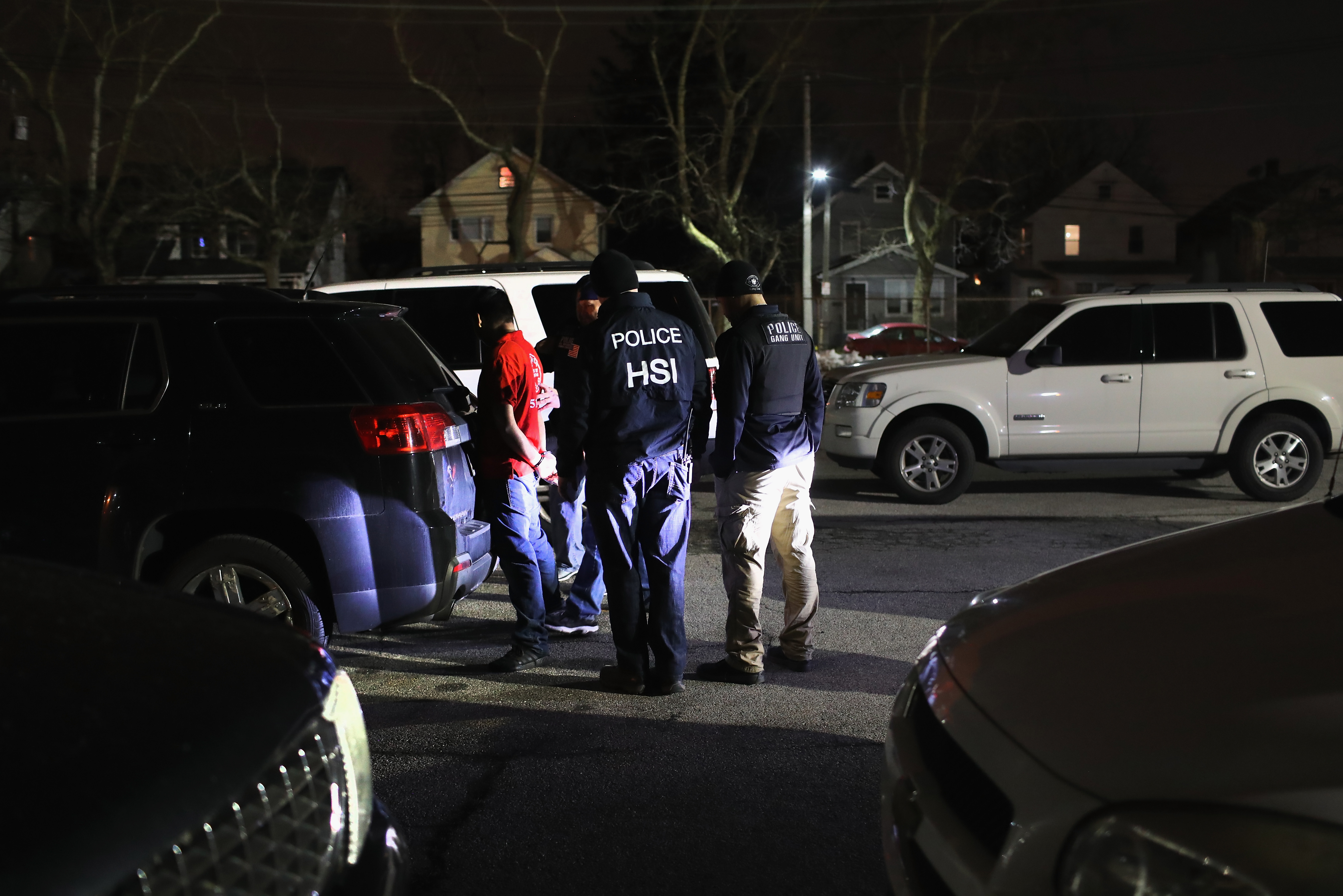 U.S. federal agents arrest a suspected gang member late on March 28, 2018, in Hempstead, New York. (Getty)