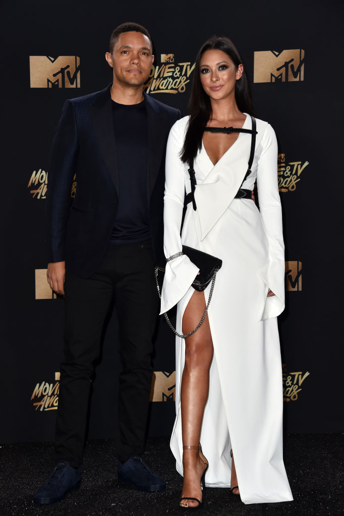 TV personality Trevor Noah and singer Jordyn Taylor attend the 2017 MTV Movie And TV Awards at The Shrine Auditorium on May 7, 2017, in Los Angeles (Source: Alberto E. Rodriguez/Getty Images)