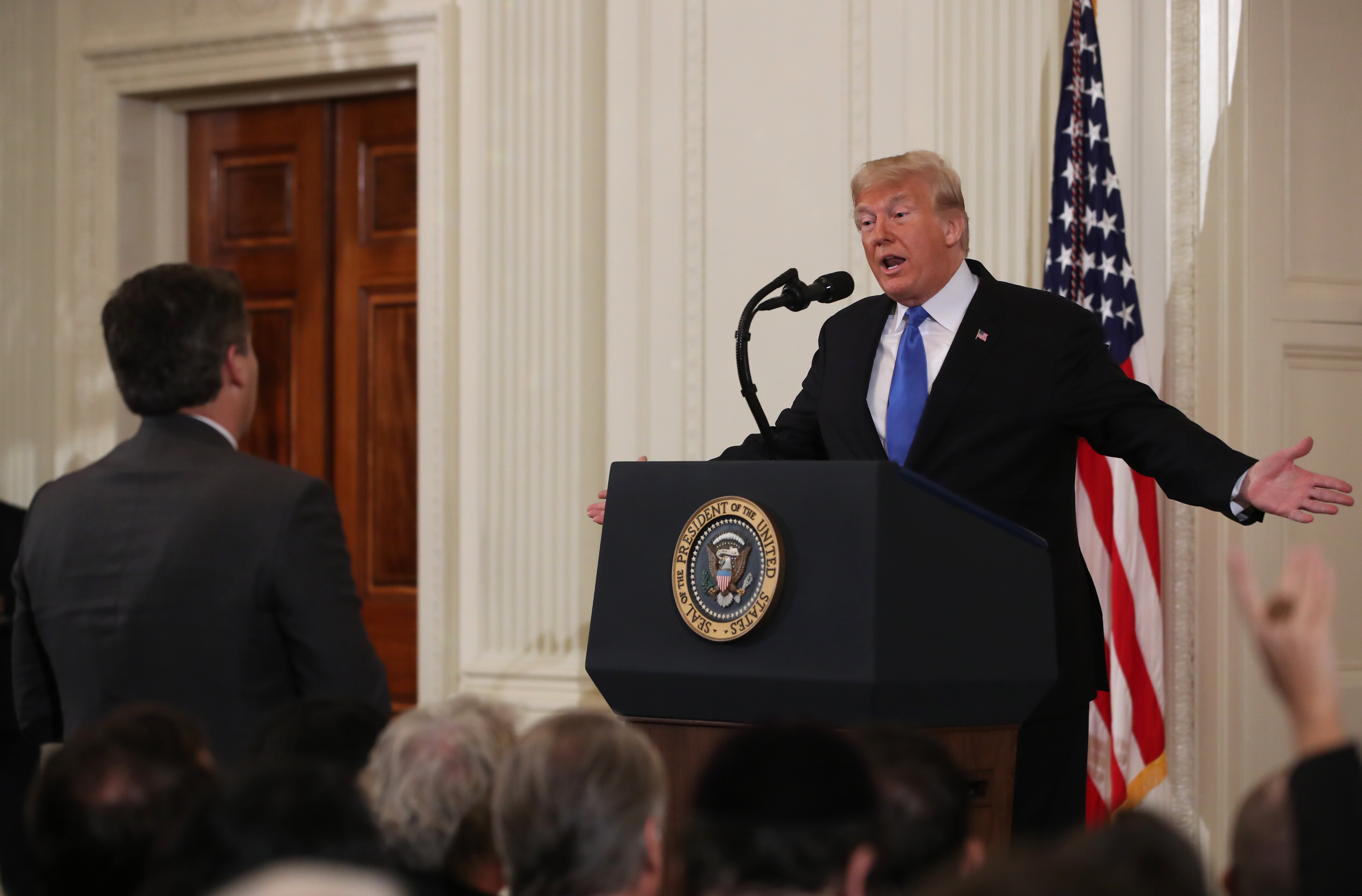 U.S. President Donald Trump gets into an exchange with Jim Acosta of CNN after giving remarks a day after the midterm elections on November 7, 2018 in the East Room of the White House in Washington, DC. Republicans kept the Senate majority but lost control of the House to the Democrats.