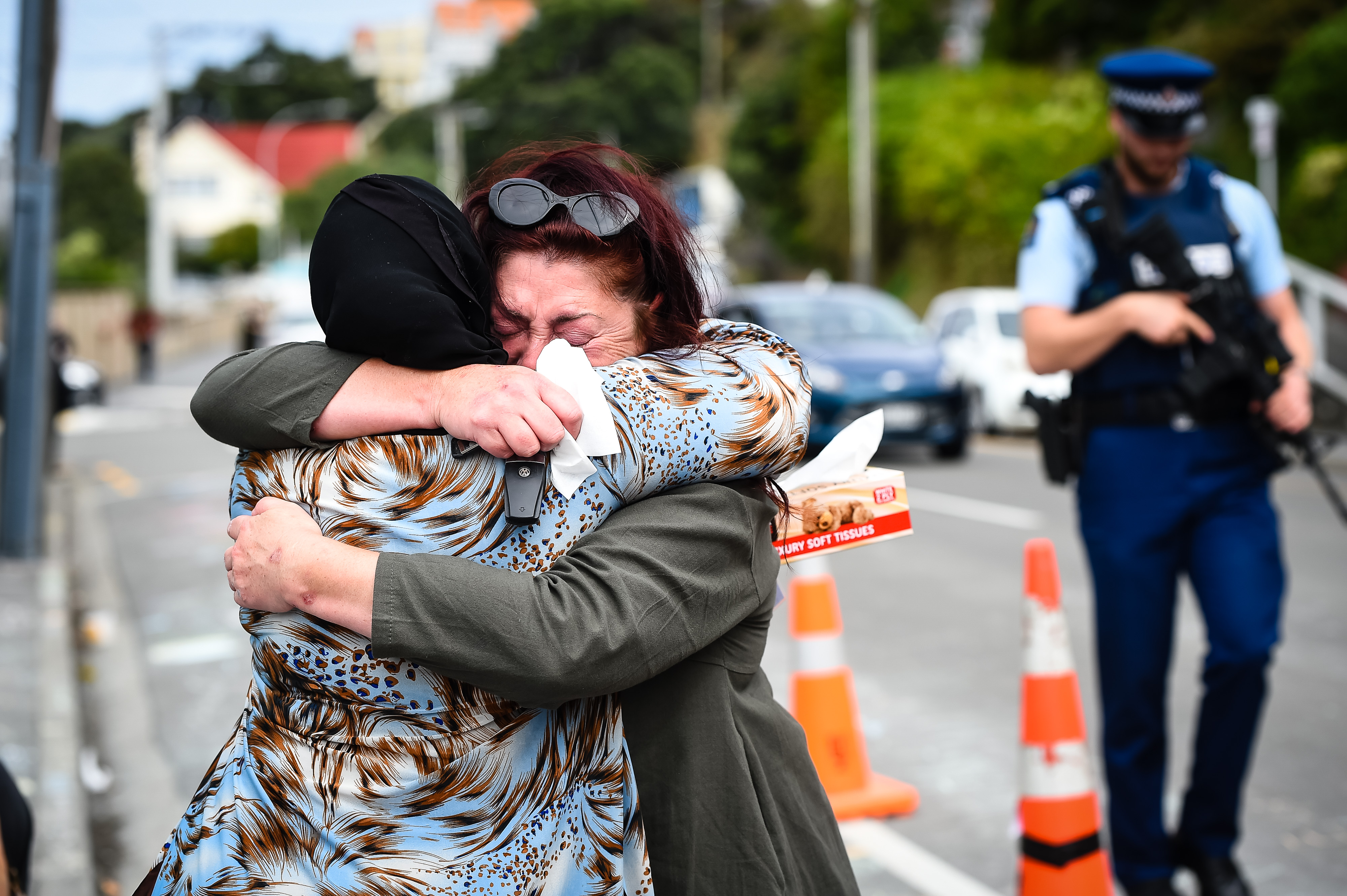 People embrace at the Kilbirnie Mosque on March 17, 2019 in Wellington, New Zealand. 50 people are confirmed dead and 36 are injured still in hospital following shooting attacks on two mosques in Christchurch on Friday, 15 March. The attack is the worst mass shooting in New Zealand's history. (Getty Images)