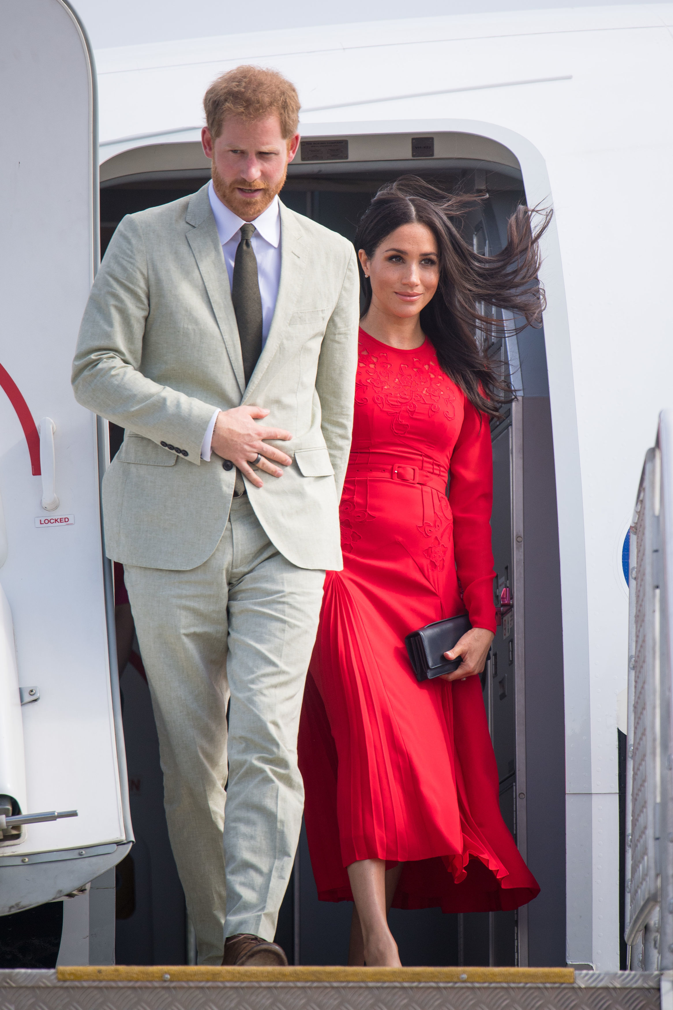 Prince Harry, Duke of Sussex and Meghan, Duchess of Sussex arrive at Fua'amotu Airport on October 25, 2018 in Nuku'Alofa, Tonga. The Duke and Duchess of Sussex are on their official 16-day Autumn tour visiting cities in Australia, Fiji, Tonga and New Zealand (Getty Images)