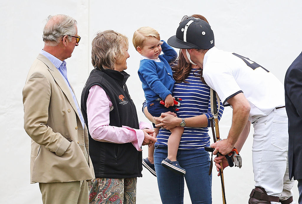 Prince Charles, Prince of Wales, looks on as his son talks to Prince George of Cambridge and Catherine, Duchess of Cambridge as they attend the Gigaset Charity Polo Match at Beaufort Polo Club on June 14, 2015 in Tetbury, England. (Photo by Chris Jackson/Getty Images)