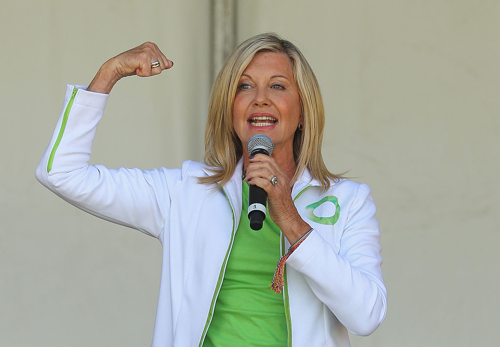 Australian actress, Olivia Newton-John performs her song 'Physical' on stage before leading the inaugural Wellness Walk on September 15, 2013 in Melbourne, Australia. (Photo by Scott Barbour/Getty Images)