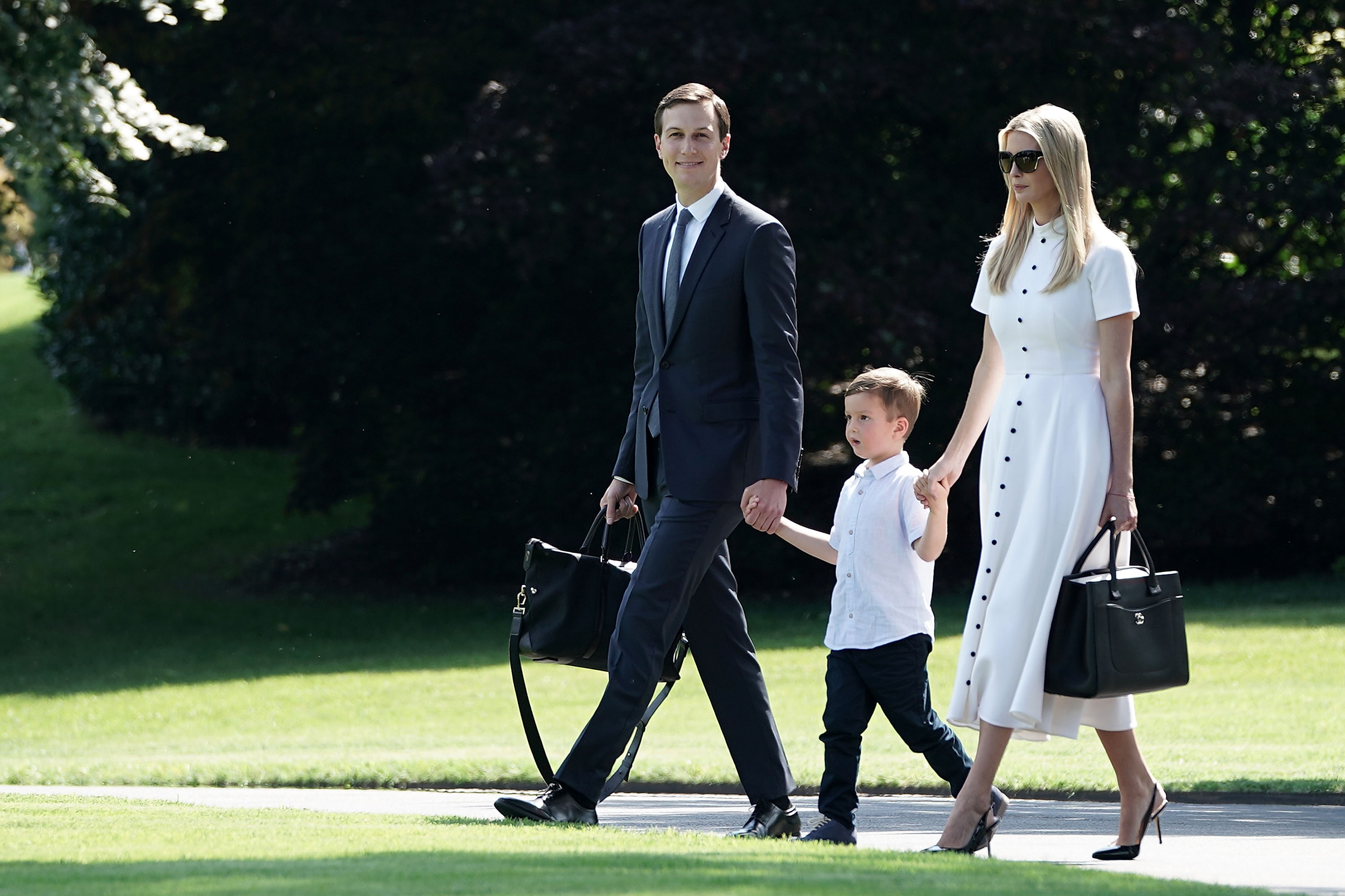 Ivanka Trump (R), White House senior adviser and daughter of President Donald Trump, walks with her husband Jared Kushner (L) and their son Joseph Kushner (2nd L) on the South Lawn of the White House prior to a Marine One departure June 29, 2018 in Washington, DC.