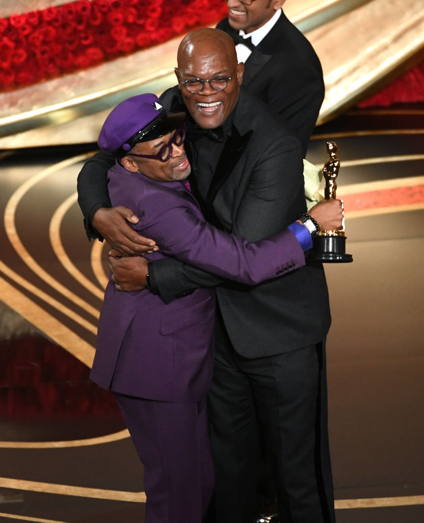 Spike Lee accepts the Adapted Screenplay award for 'BlacKkKlansman' from Samuel L. Jackson onstage during the 91st Annual Academy Awards at Dolby Theatre on February 24, 2019 in Hollywood, California. (Getty Images)