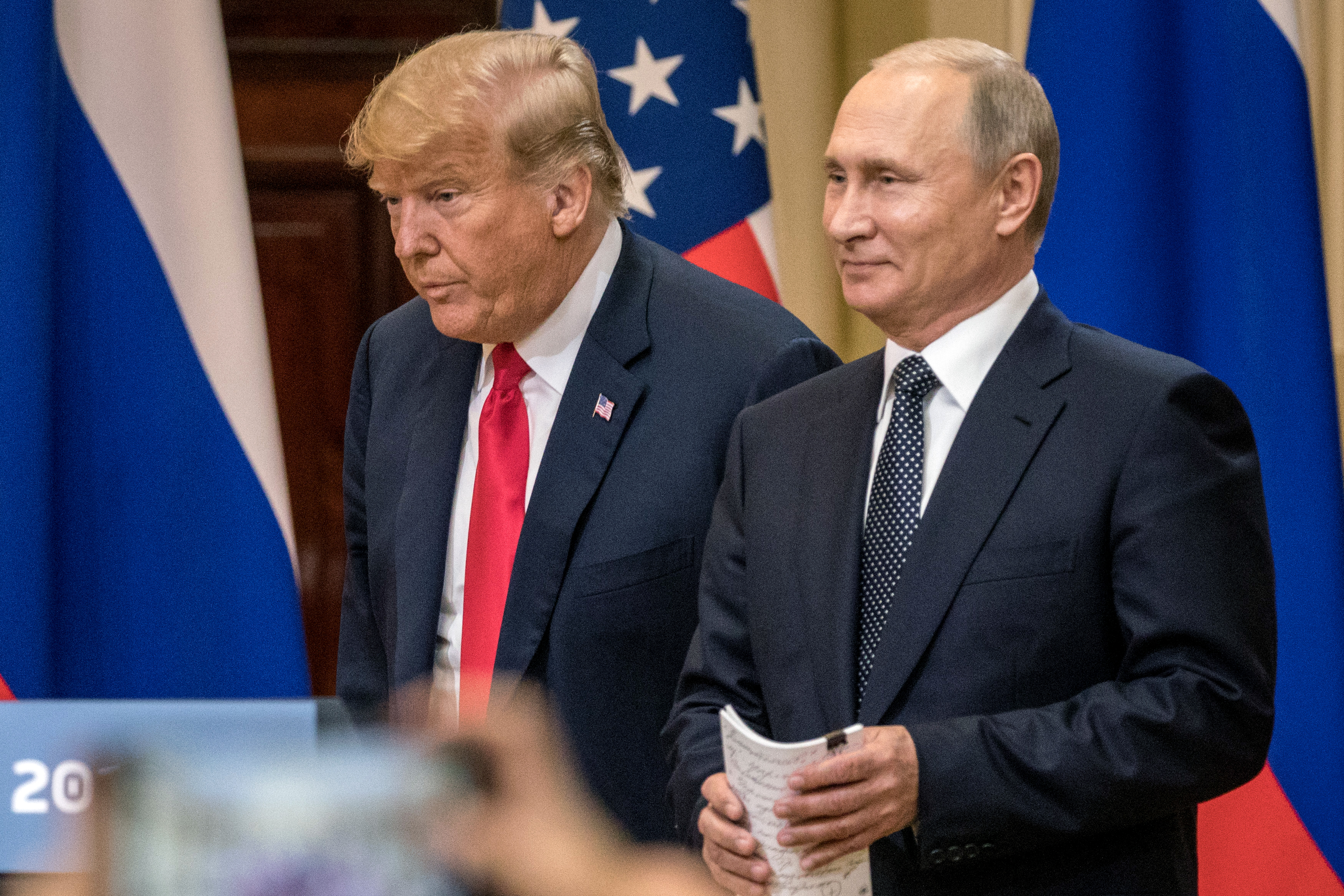 U.S. President Donald Trump (L) and Russian President Vladimir Putin arrive to waiting media during a joint press conference after their summit on July 16, 2018 in Helsinki, Finland. The two leaders met one-on-one and discussed a range of issues including the 2016 U.S Election collusion. (Getty Images)