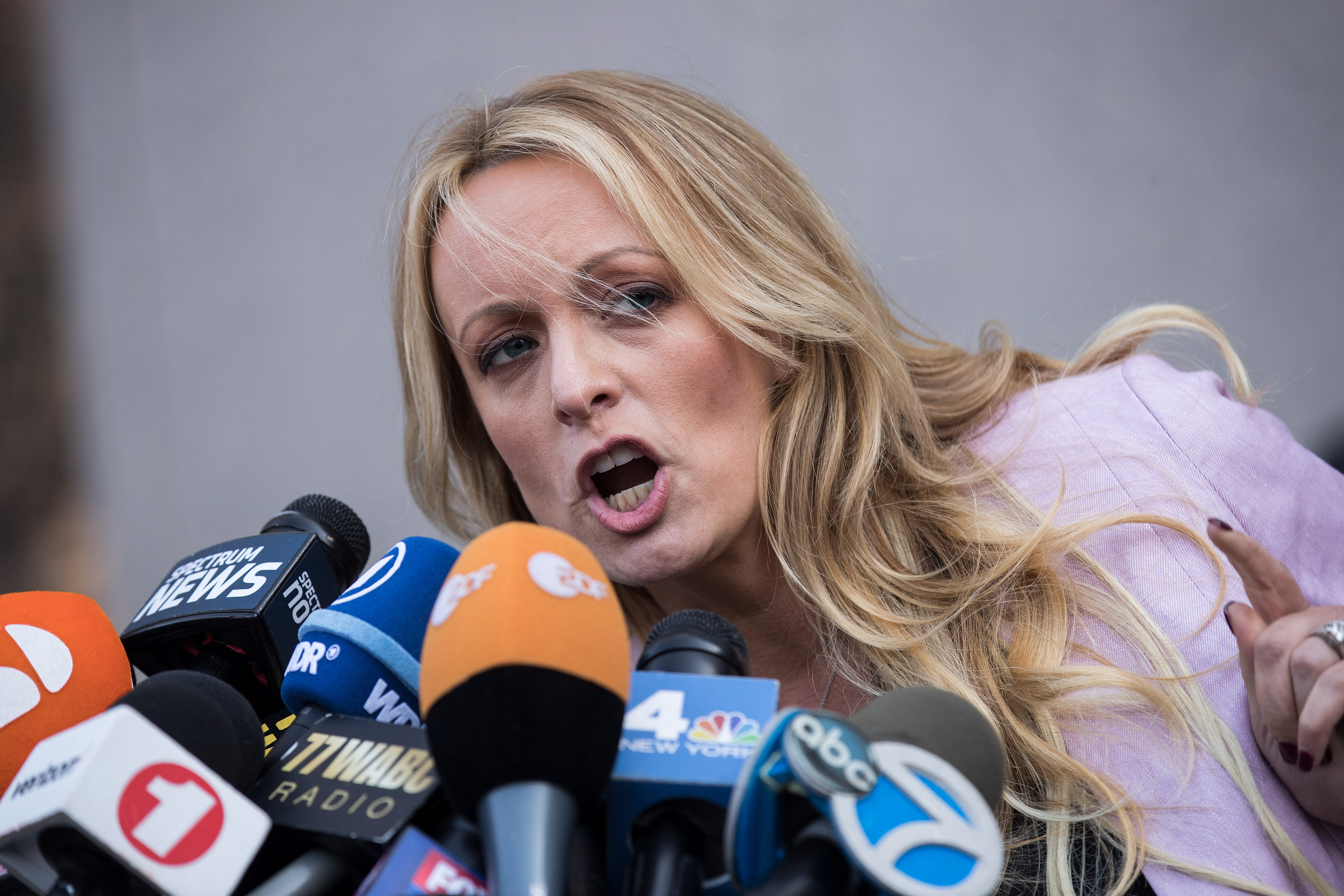 Adult film actress Stormy Daniels (Stephanie Clifford) speaks to reporters as she exits the United States District Court Southern District of New York for a hearing related to Michael Cohen, President Trump's longtime personal attorney and confidante, April 16, 2018 in New York City.