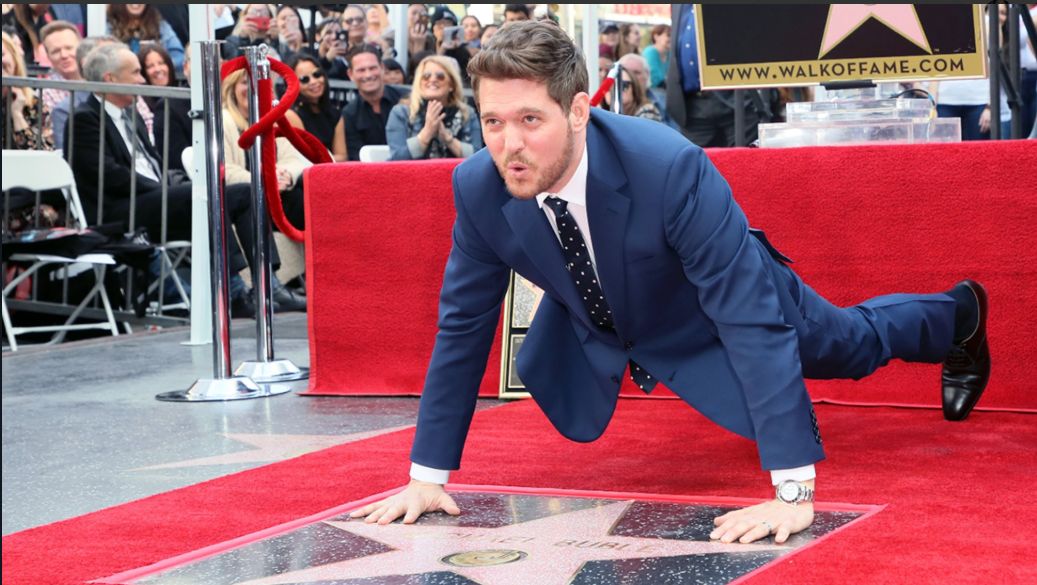 Michael Buble doing a push up over his Hollywood Walk of Fame star. (Source: Twitter)