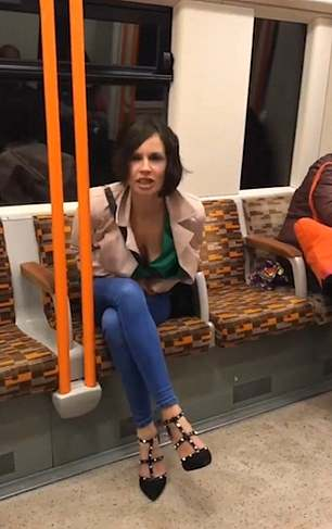 The woman launched a racist rant against a fellow passenger (Source: YouTube)