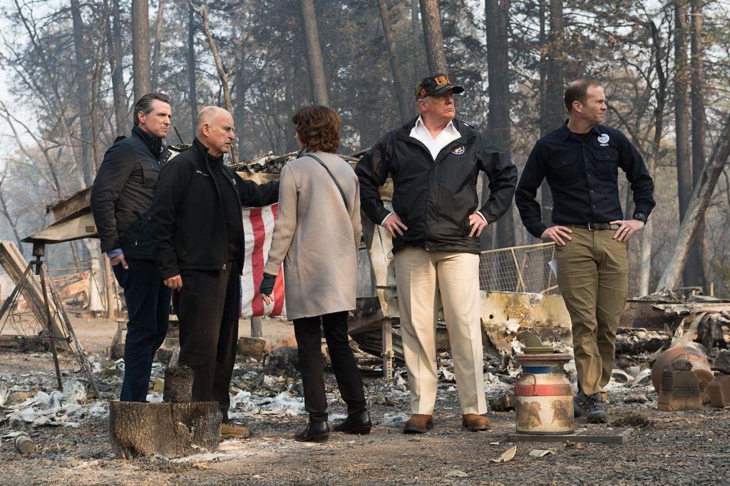 Gov.-elect Gavin Newson, Gov. Jerry Brown, Paradise mayor Jody Jones, President Donald Trump, and FEMA Director Brock Long, tour the Skyway Villa Mobile Home and RV Park with Gov. Jerry Brown during his visit of the Camp Fire in Paradise, California on November 17, 2018. (Getty Images)