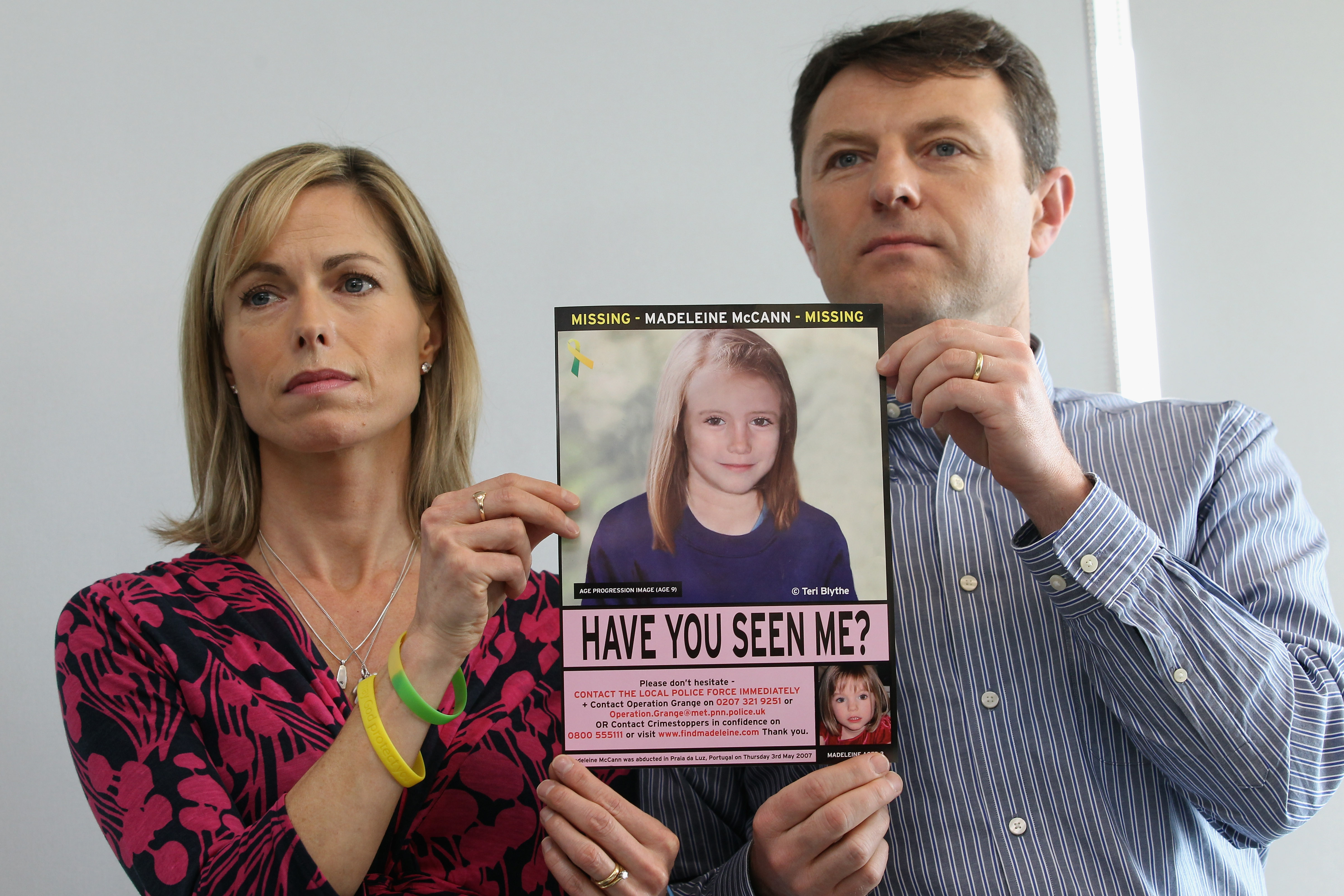 Kate and Gerry McCann hold an age-progressed police image of their daughter during a news conference to mark the 5th anniversary of the disappearance of Madeleine McCann, on May 2, 2012, in London, England. (Getty Images)