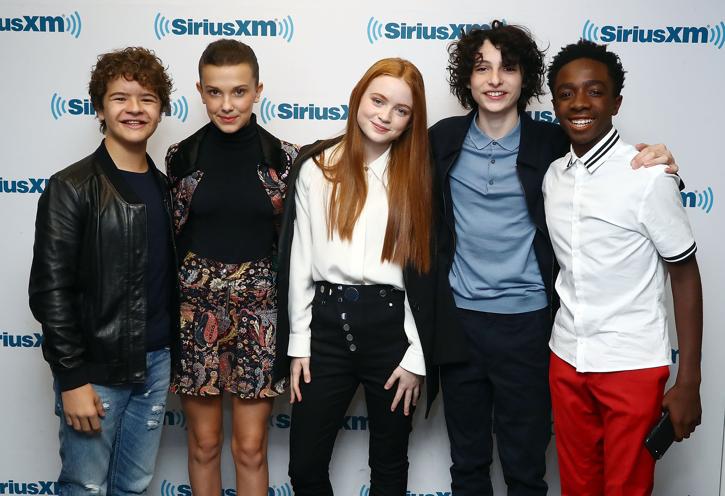 (L-R) Actors Gaten Matarazzo, Millie Bobby Brown, Sadie Sink, Finn Wolfhard and Caleb McLaughlin attend SiriusXM's 'Town Hall' cast of Stranger Things on SiriusXM's Entertainment Weekly Radio on November 1, 2017 in New York City.