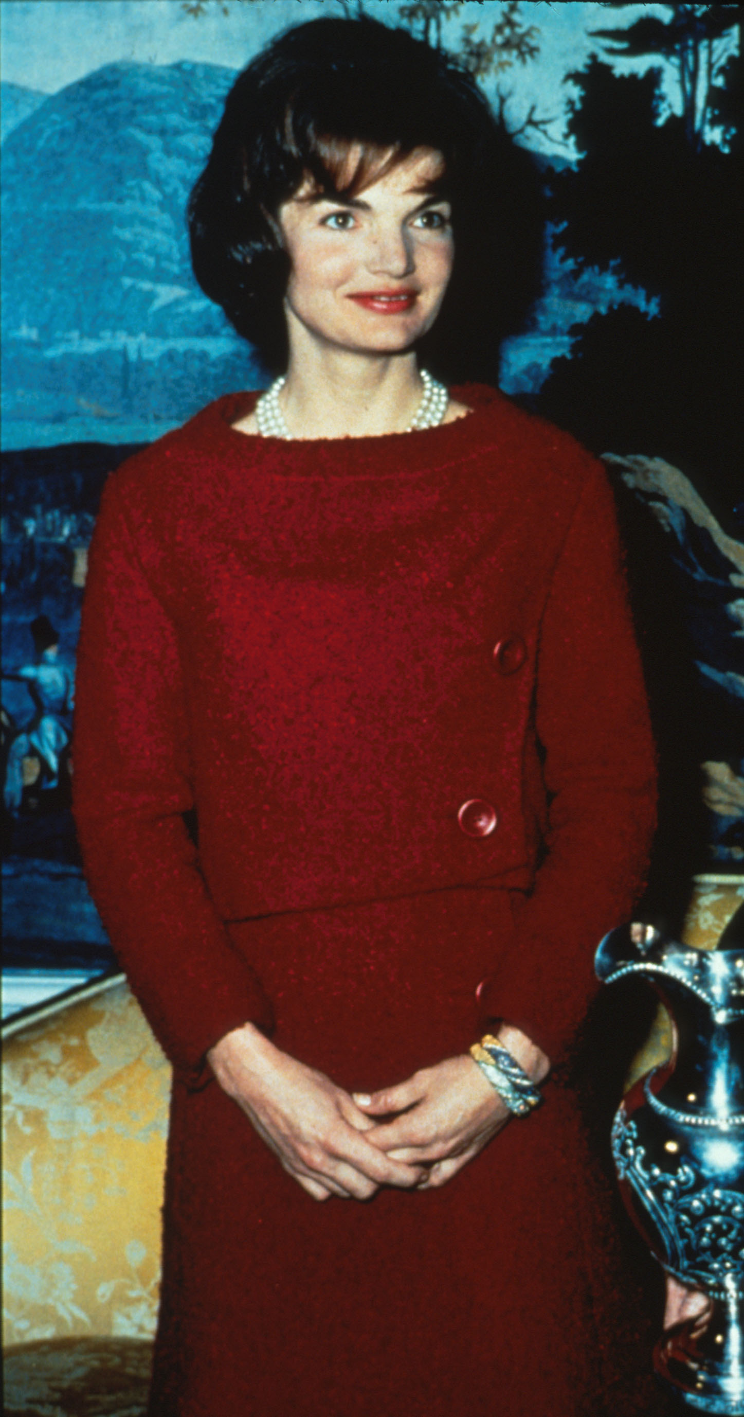 First Lady Jacqueline Kennedy wears a Chez Ninon two-piece day dress on February 14, 1962, during a nationally televised Valentine's Day tour of The White House in Washington, DC. (Getty Images)