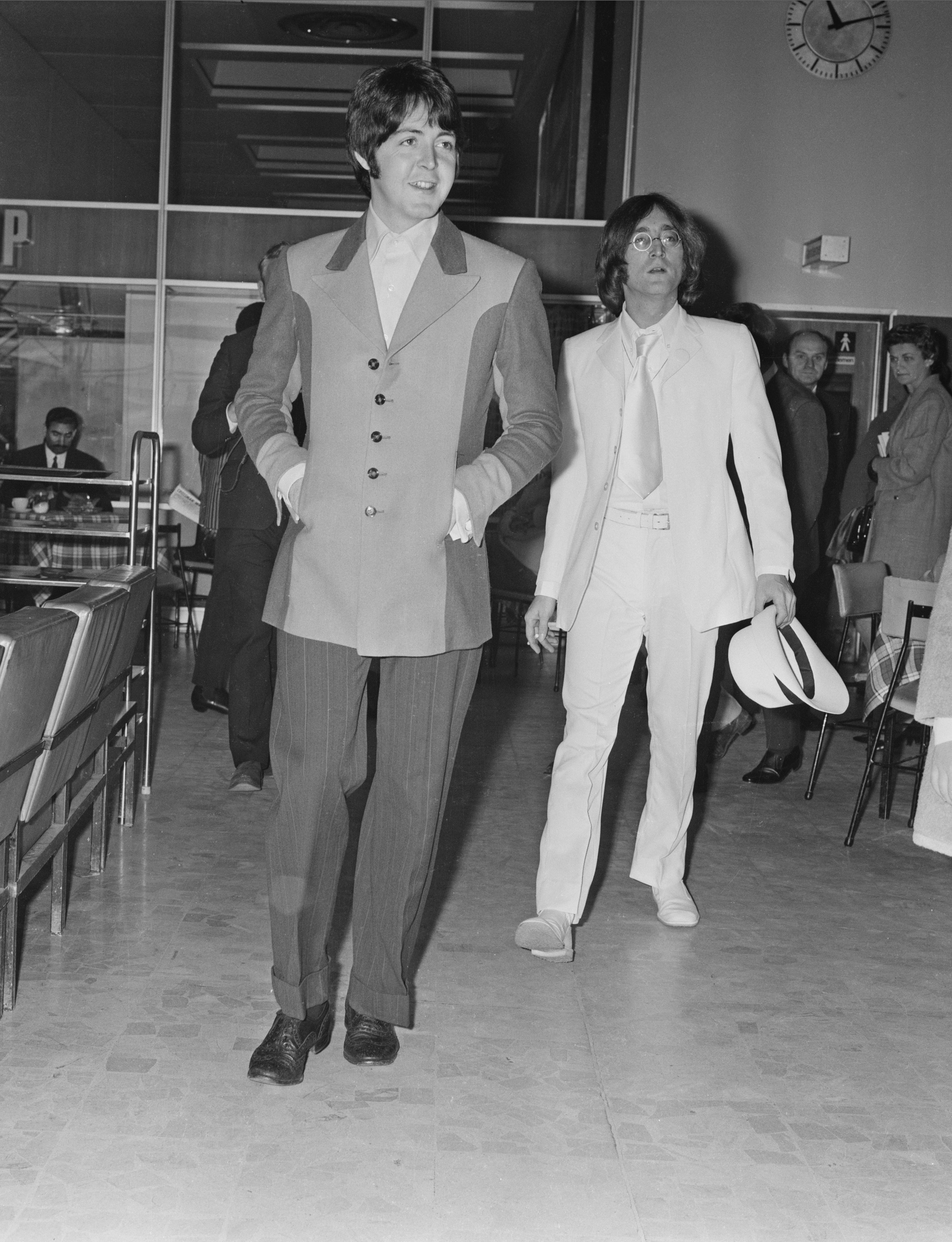 British musicians of the Beatles, Paul McCartney and John Lennon (1940 - 1980) at Heathrow Airport, London, UK, 12th May 1968. (Photo by Dove/Daily Express/Getty Images)