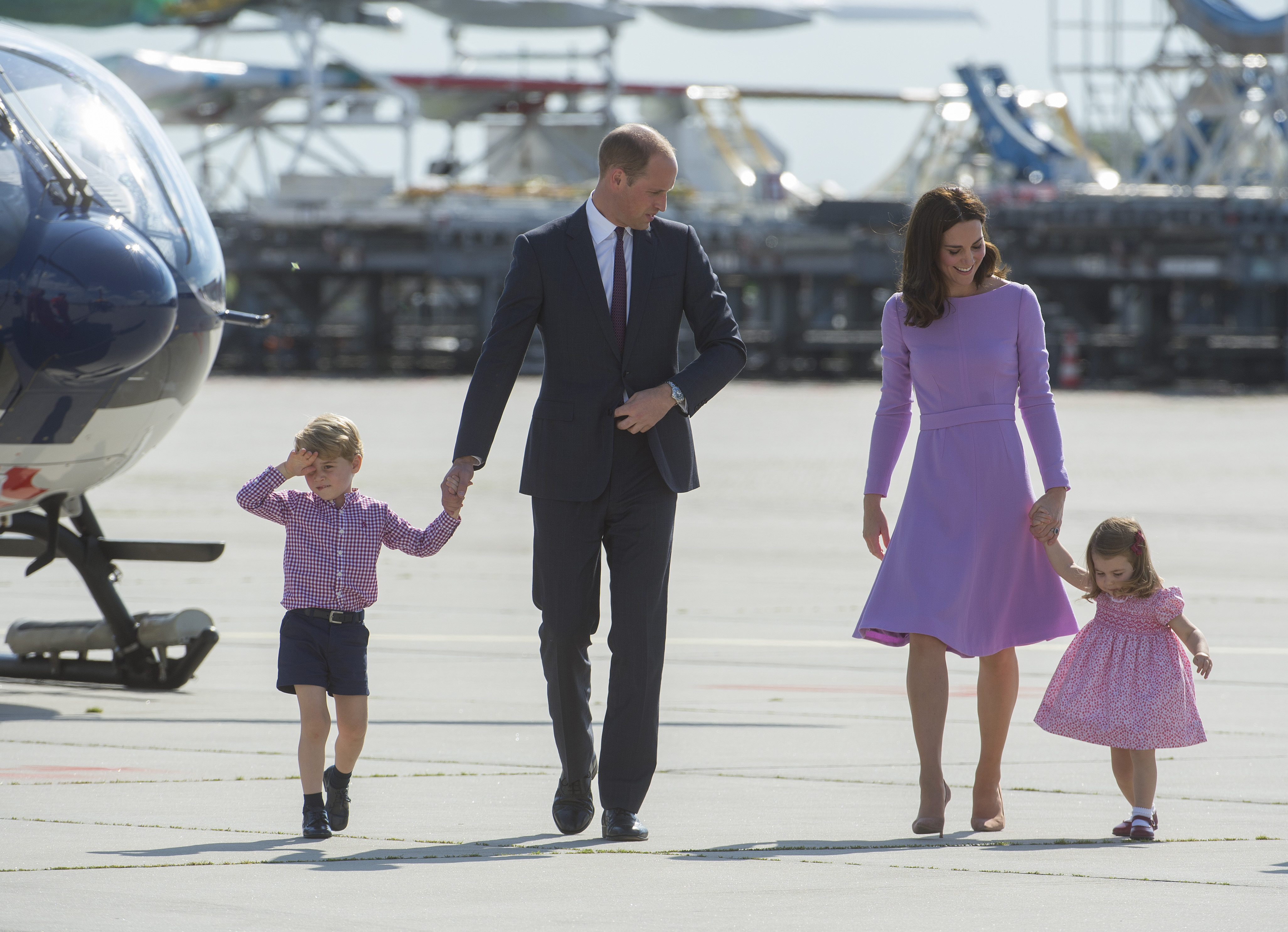 Prince William, Duke of Cambridge, Prince George of Cambridge, Princess Charlotte of Cambridge and Catherine, Duchess of Cambridge depart from Hamburg airport on the last day of their official visit to Poland and Germany on July 21, 2017 in Hamburg, Germany.