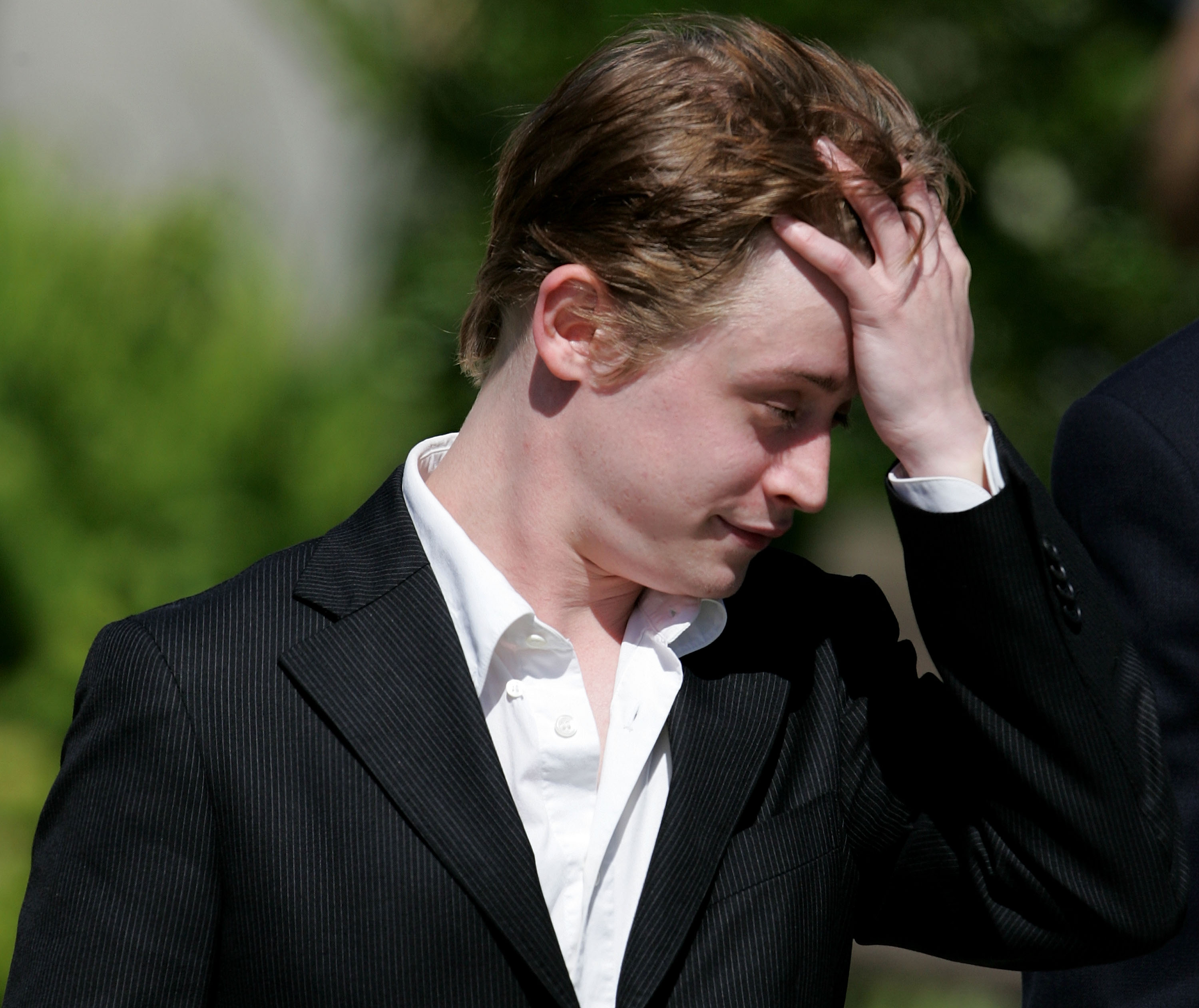 Actor Macaulay Culkin leaves the Santa Barbara County Courthouse after testifying in Michael Jackson's child molestation trial May 11, 2005 in Santa Maria, California. Jackson is charged in a 10-count indictment with molesting a boy, plying him with liquor and conspiring to commit child abduction, false imprisonment and extortion. (Getty Images)