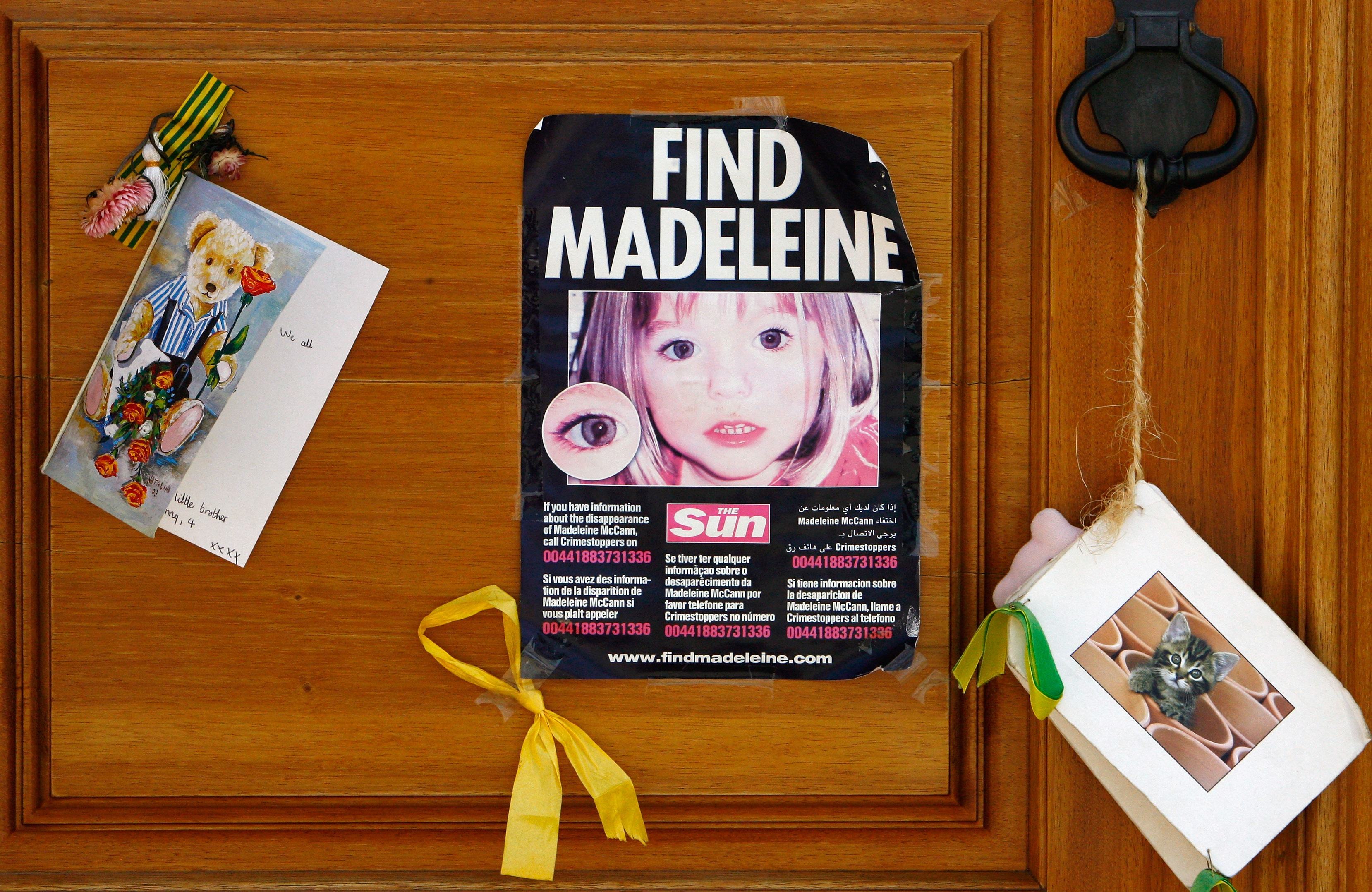 A poster and cards are placed on the Church door in Praia da Luz for missing Madeleine McCann August 9, 2007 in Praia da Luz, Portugal. Police continue there investigation in the Algarve village after blood was found in the McCann Apartment. (Getty Images)