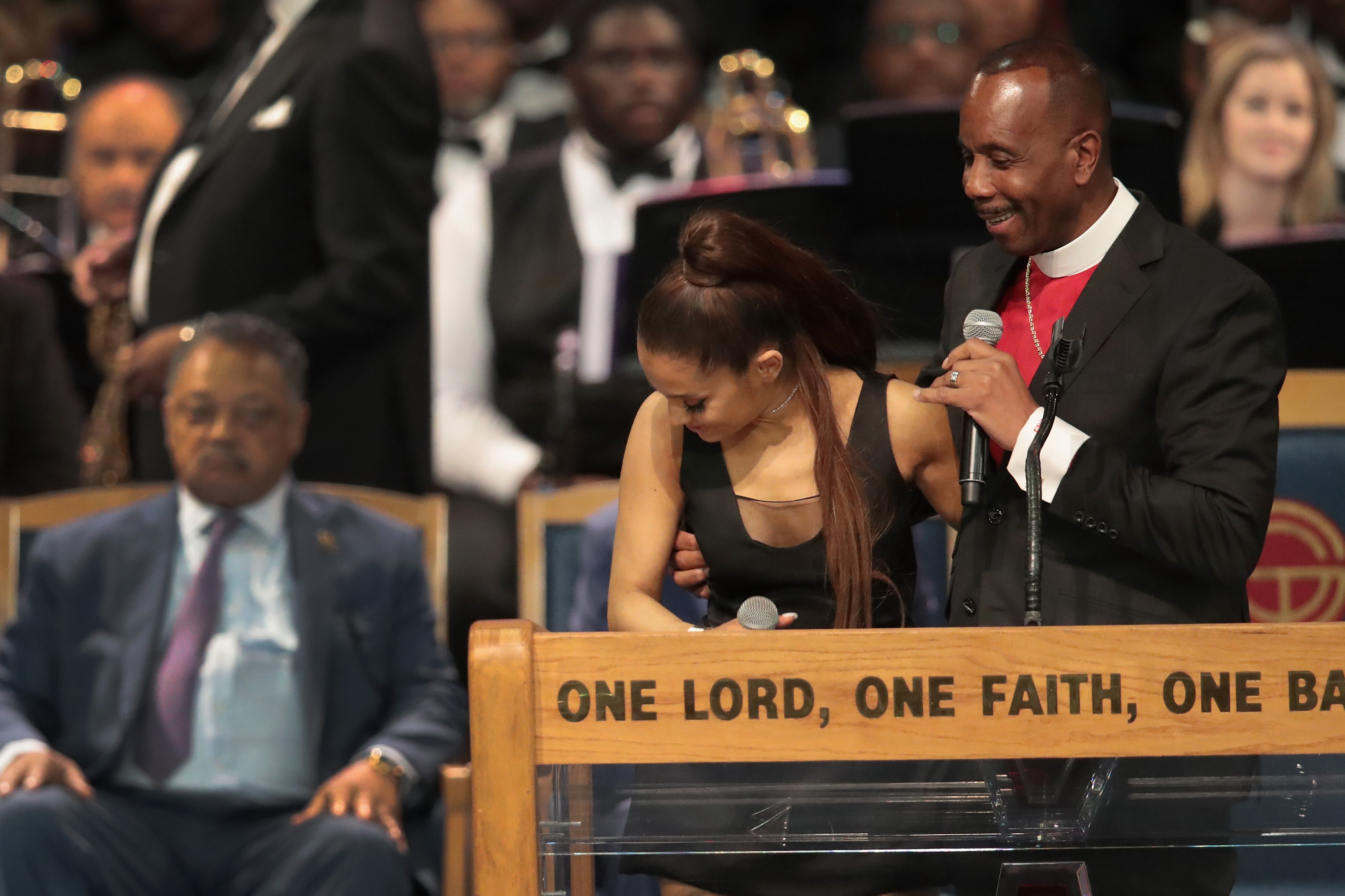 The bishop appeared to touch the side of Ariana's breast (Source: Scott Olson/Getty Images)