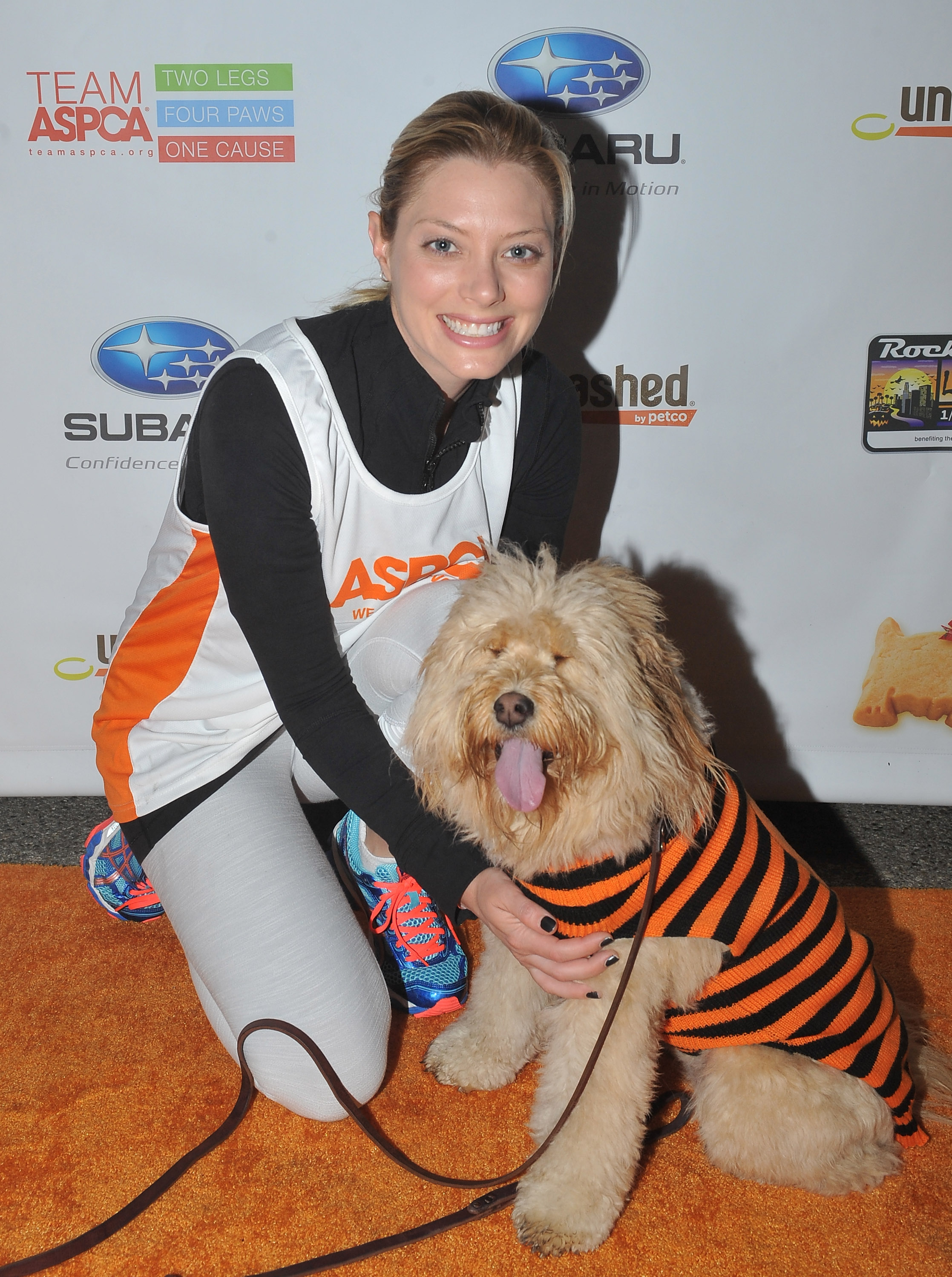 Actress April Bowlby and her dog Clementine attend the Rock 'n' Roll Los Angeles Halloween Half-Marathon benefitting The ASPCA at L.A. LIVE on October 27, 2013, in Los Angeles, California. (Photo by Angela Weiss/Getty Images for ASPCA)