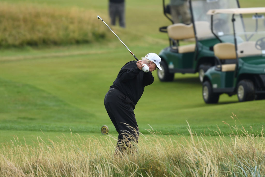 President Donald Trump hits a tee shot while playing a round of golf at Trump Turnberry Luxury Collection Resort during the U.S. President's first official visit to the United Kingdom on July 15, 2018, in Turnberry, Scotland (Getty Images)