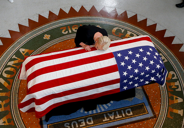 Cindy McCain touches the casket during his memorial service at the Capitol on August 29, 2018 in Phoenix (Photo by Ross D. Franklin-Pool via Getty Images)