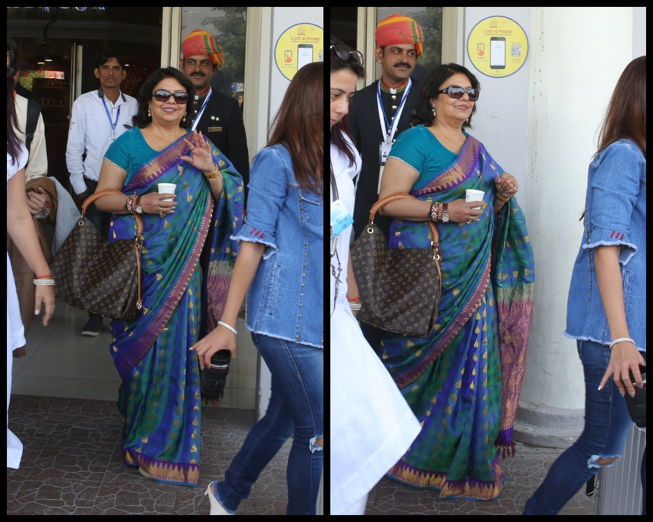 Madhu Chopra and other relatives were all smiling for the waiting cameras at the Jodhpur airport. (Source: Meaww)