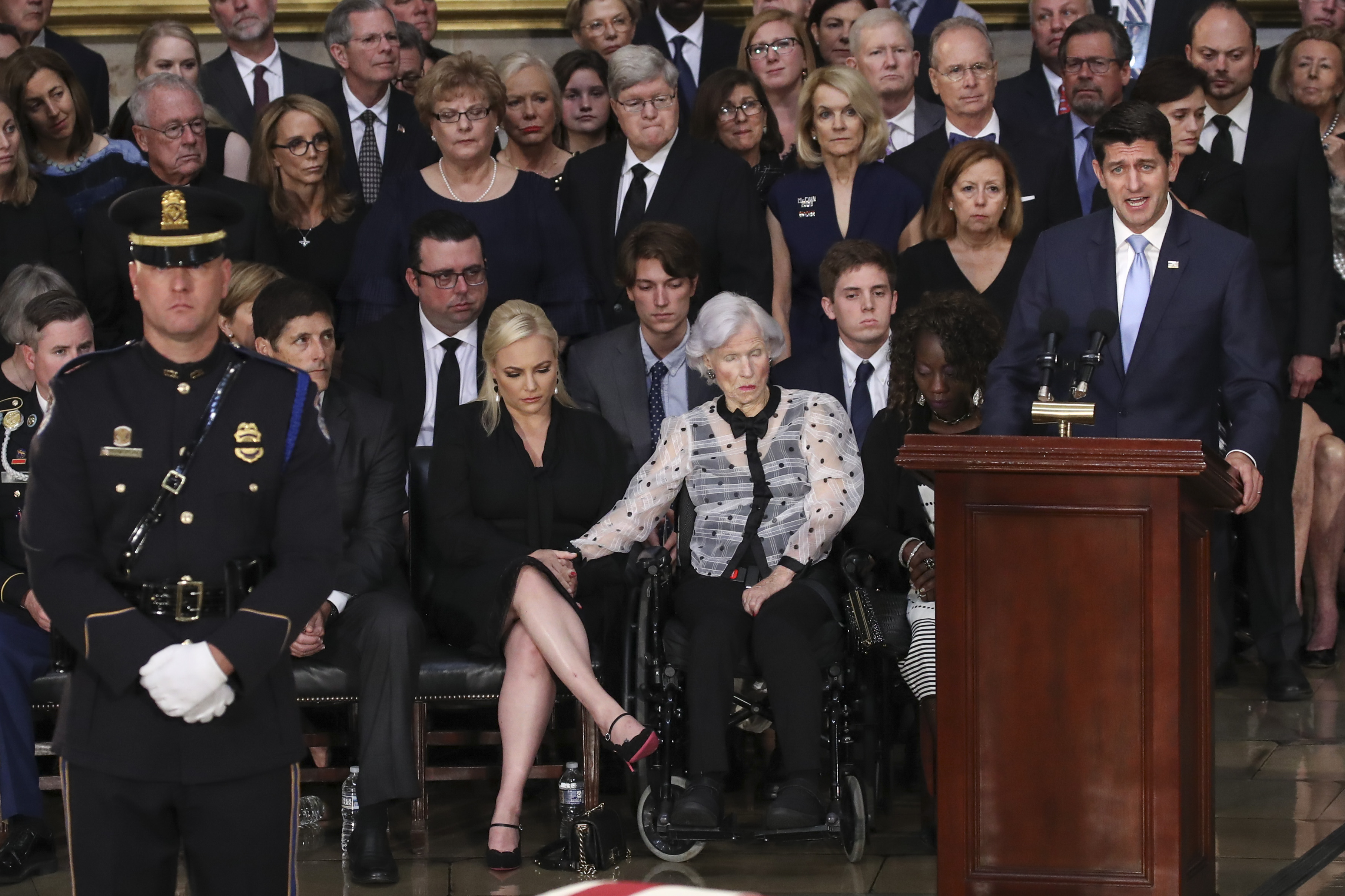(L-R) Meghan McCain is comforted by her grandmother Roberta McCain as Speaker of the House Paul Ryan (R-WI) speaks during a ceremony for the late-Sen. John McCain (R-AZ) in the Rotunda of the U.S. Capitol, August 31, 2018 in Washington, DC. (Getty Images)