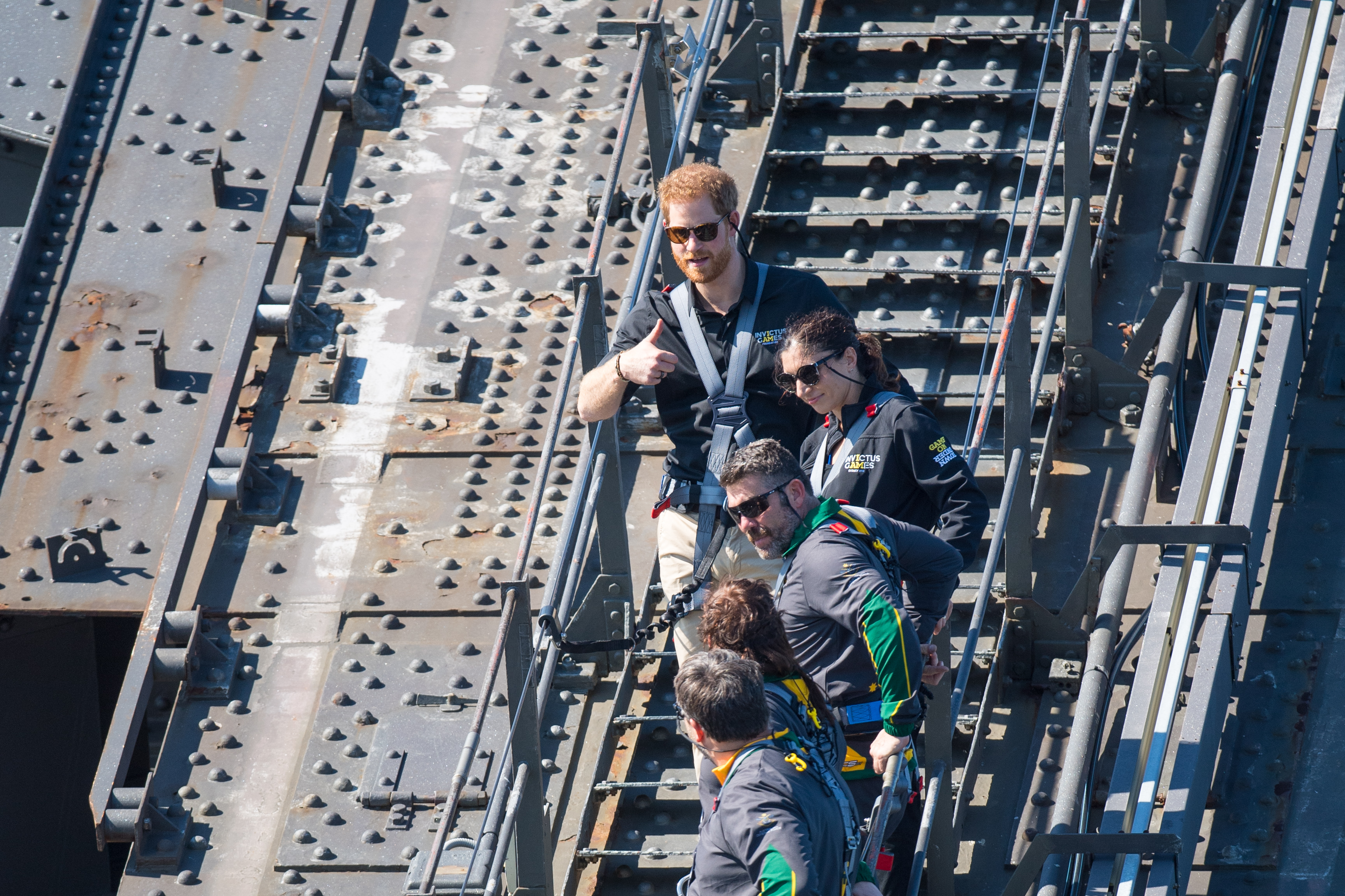 Prince Harry, Duke of Sussex climbs the Sydney Harbour Bridge with Prime Minister of Australia Scott Morrison and Invictus Games competitors on October 19, 2018, in Sydney, Australia. The Duke and Duchess of Sussex are on their official 16-day Autumn tour visiting cities in Australia, Fiji, Tonga, and New Zealand. (Getty Images)