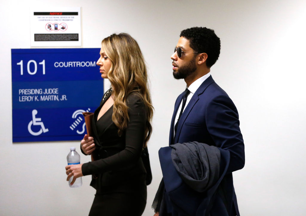 Actor Jussie Smollett (R) and attorney Tina Glandian at Leighton Criminal Courthouse for his court appearance on March 14, 2019, in Chicago, Illinois. (Source: Getty Images)