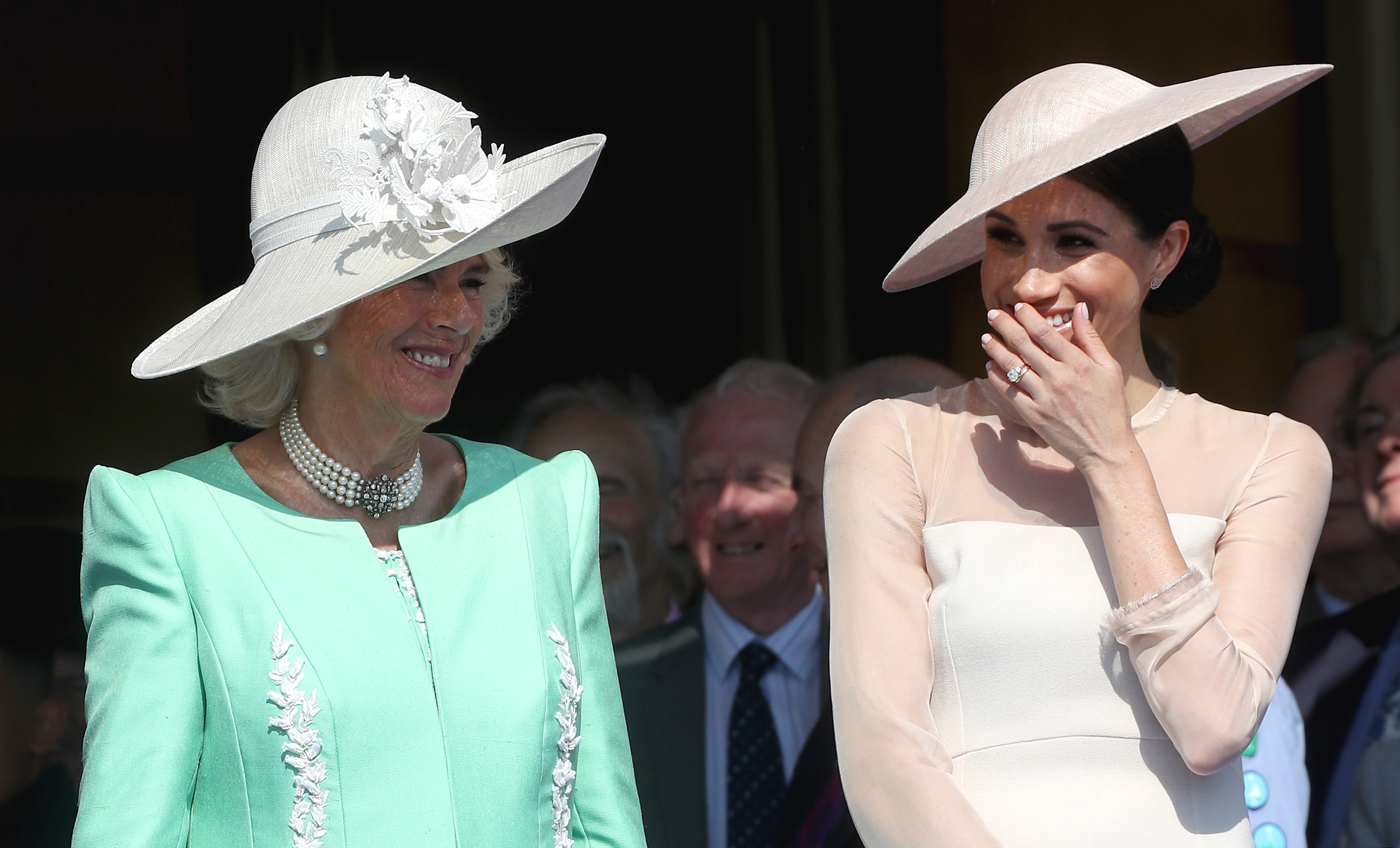 (L-R) Camilla, Duchess of Cornwall and Meghan, Duchess of Sussex attend The Prince of Wales' 70th Birthday Patronage Celebration held at Buckingham Palace on May 22, 2018 in London, England.